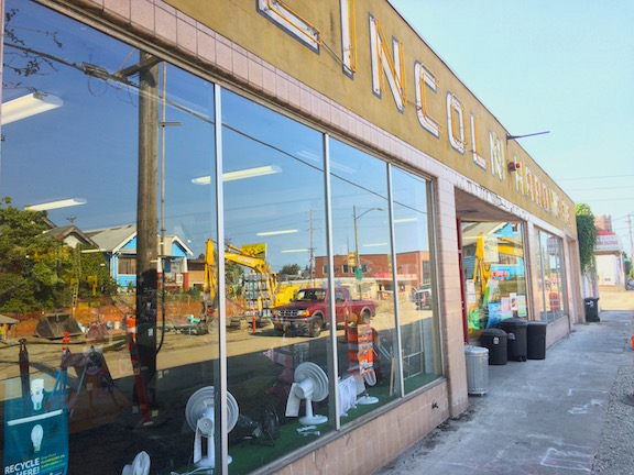 Lincoln Hardware's wide front windows reflect the reconstruction of S. G St.