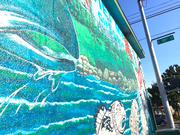 Bob Henry's leaping salmon mural on the corner of S. 38th St and S. Yakima Ave.