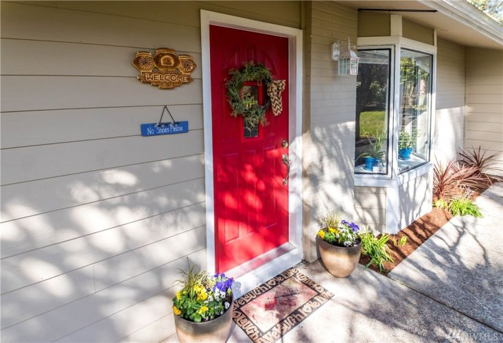 A bright front door leads into the open living space.