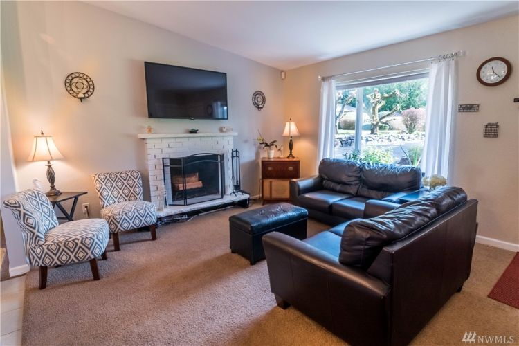 Vaulted ceiling living room is open to the kitchen so you can interact with family while preparing meals.
