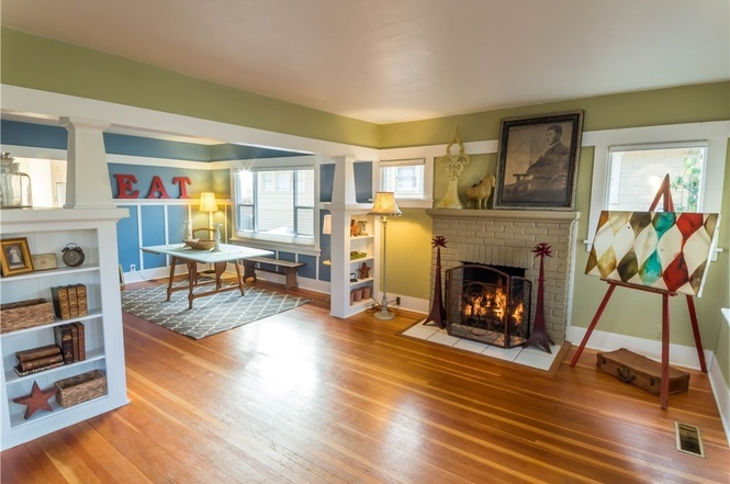 Fir floors, fire place,and built-in book shelves complete the living room.