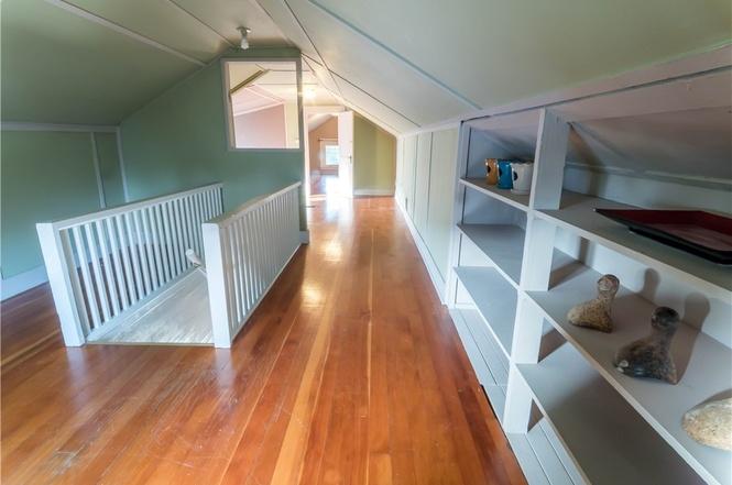 Upper floor landing and bedroom also shine with fir floors.