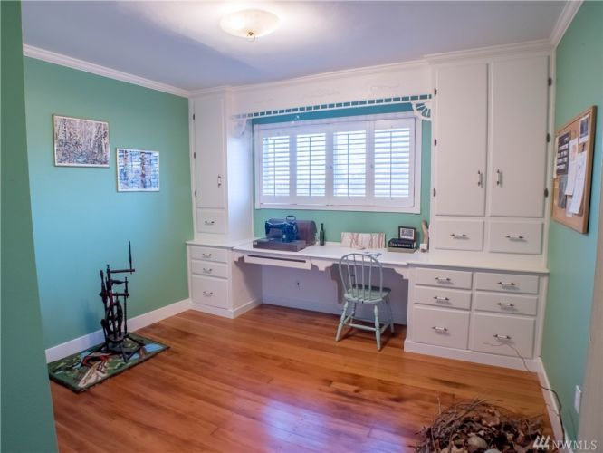 Wonderful built-ins, and a closet with shelves make this an ideal third bedroom or studio.