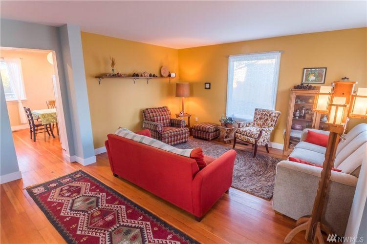 Front door opens into cozy living room.