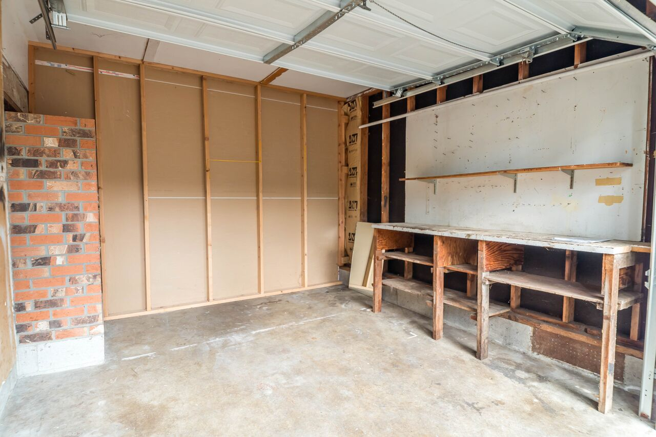 Attached garage converted into workshop.