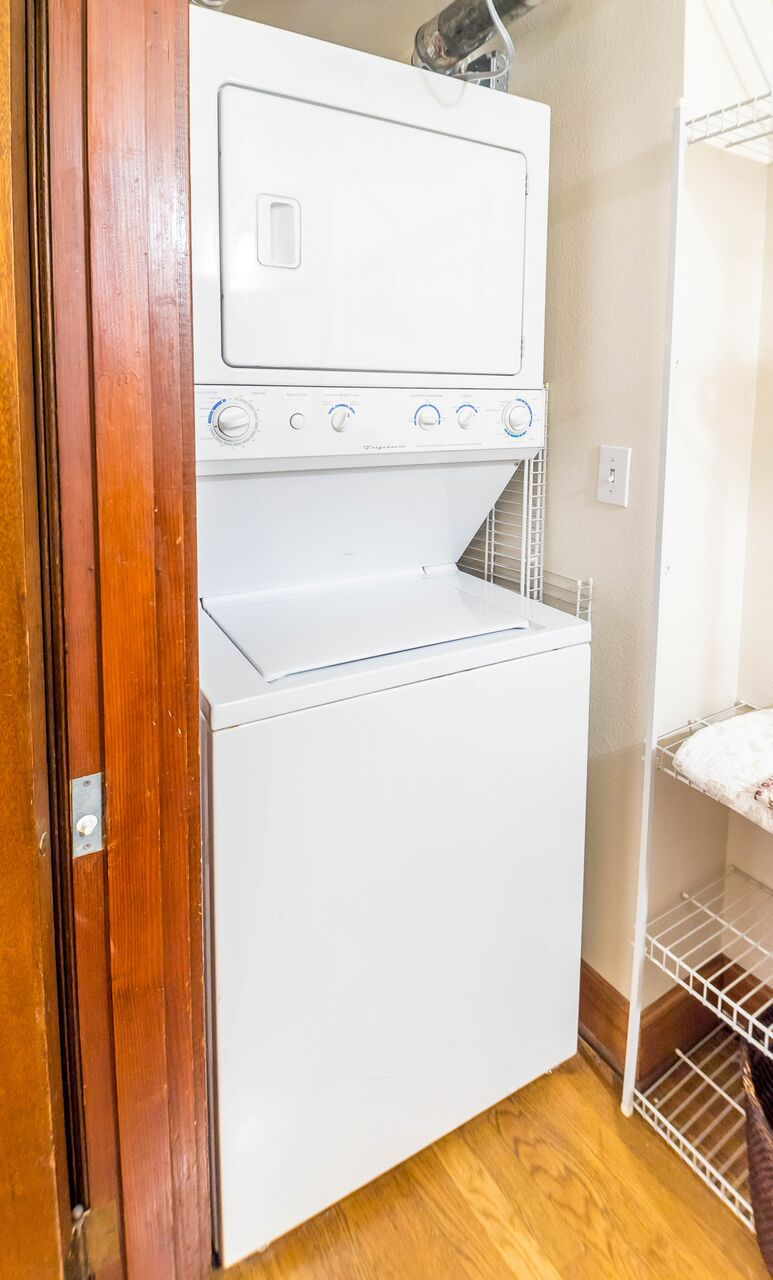 Studio is complete with its own laundry room tucked behind a door.