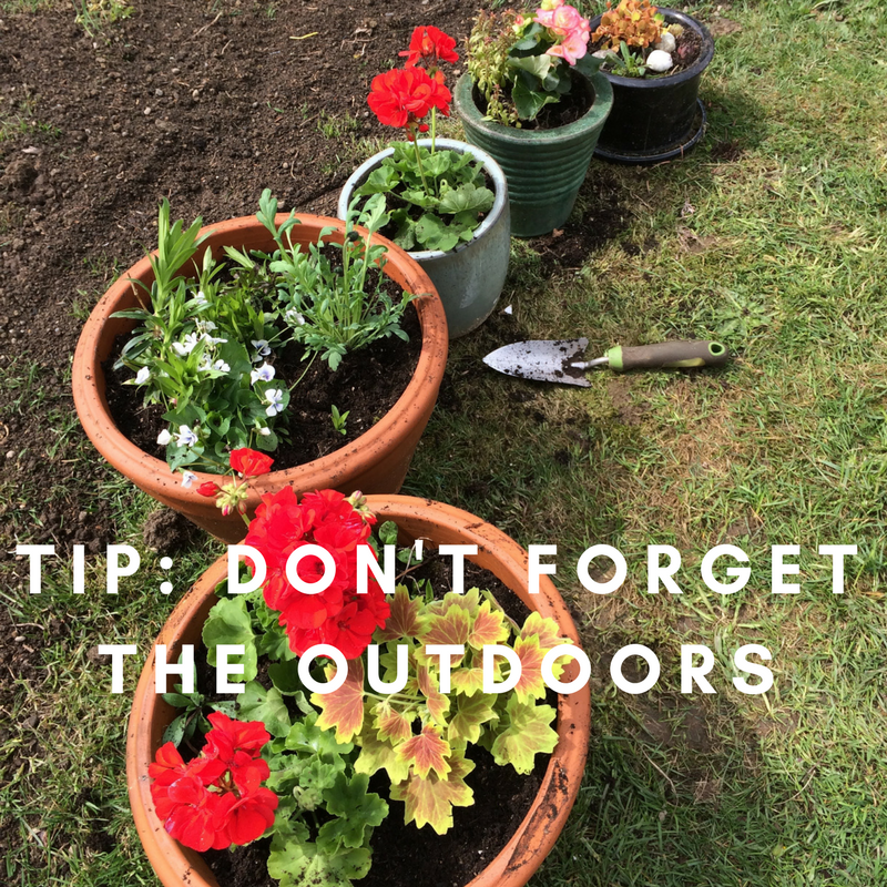 If your garden isn't blooming yet, or it's a bit past its prime, put a little effort and some resources into color-spots for your flower beds, or even pots for the porch; it doesn't take much to make a big impact here. Even if you don't plant anything new, weeding, trimming, and some fresh ground cover go a long way toward making your home welcoming.