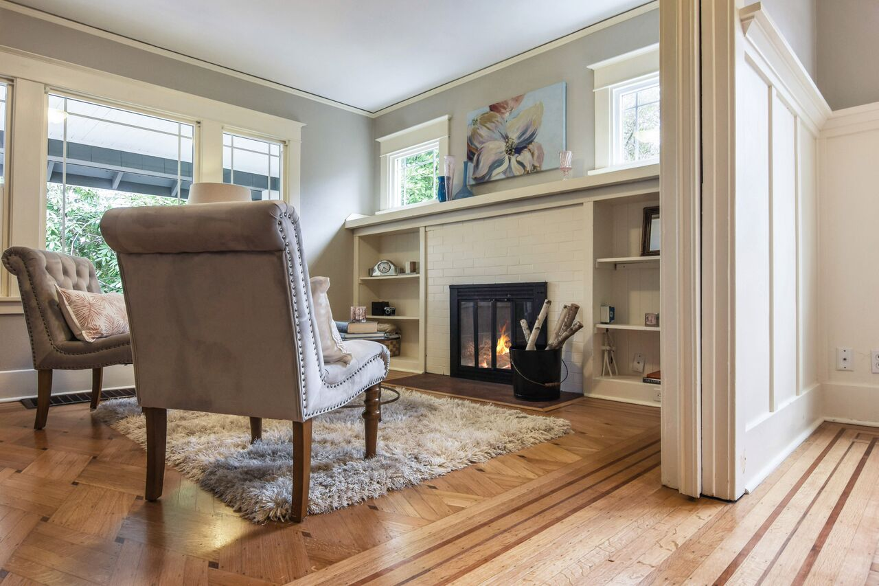A final look at the custom hardwood floor and cozy hearth.