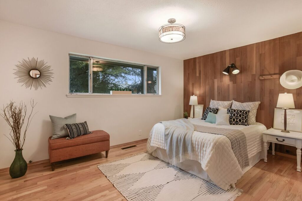 One of two main floor bedrooms (three total bedrooms in the home) with oak floors and awesome mid-century accents.