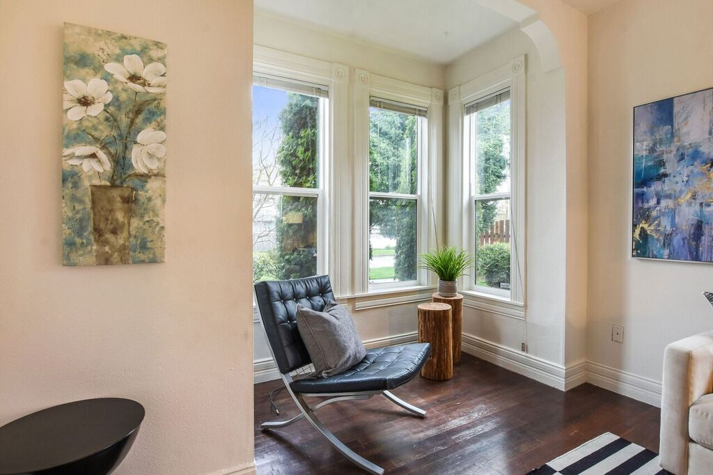 Bay windows give space and interest to the living room and bring in lots of light.
