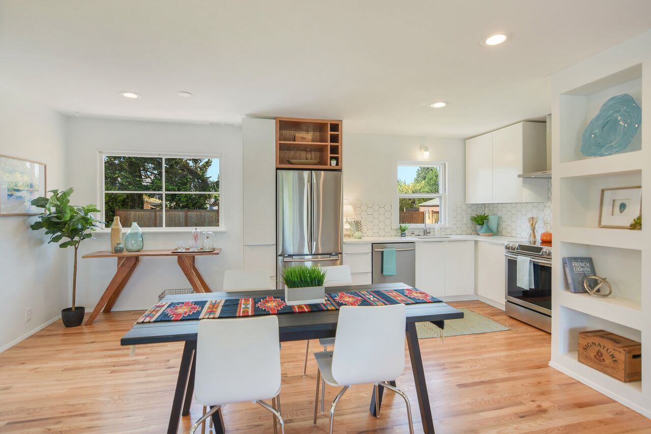 The dining area flows seamlessly into a bright renovated kitchen overlooking the back yard.