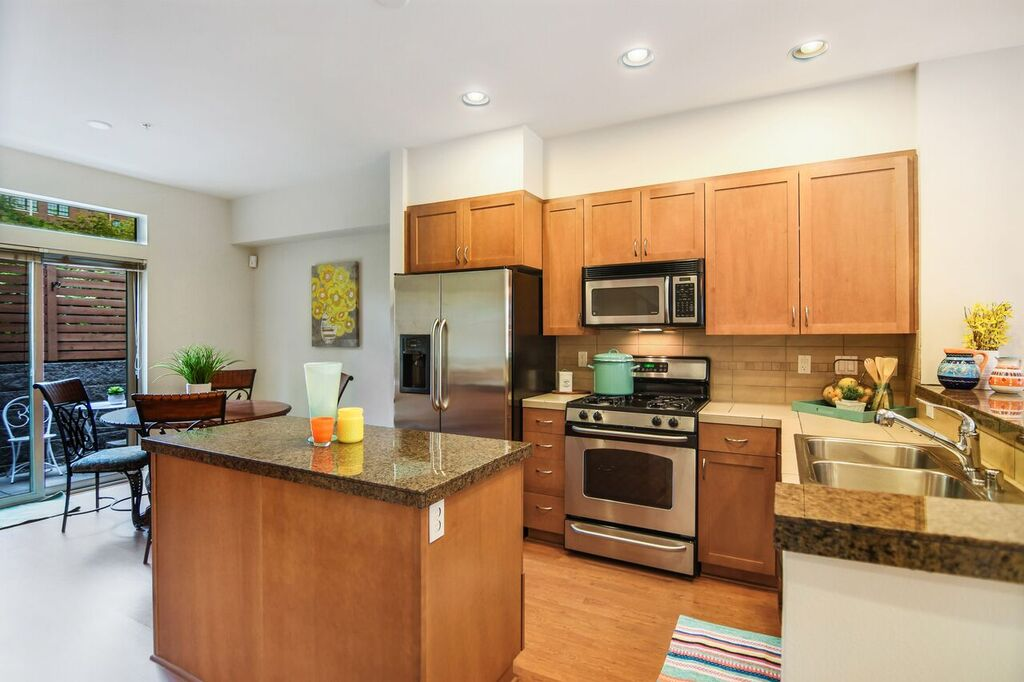 Ample cabinets and a wonderful layout for casual entertaining with this kitchen island as prep space or buffet.