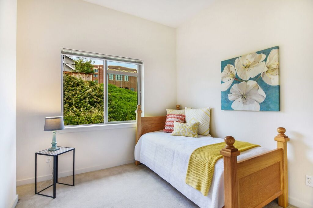 The second bedroom on the top floor is perfect for guests or family members.