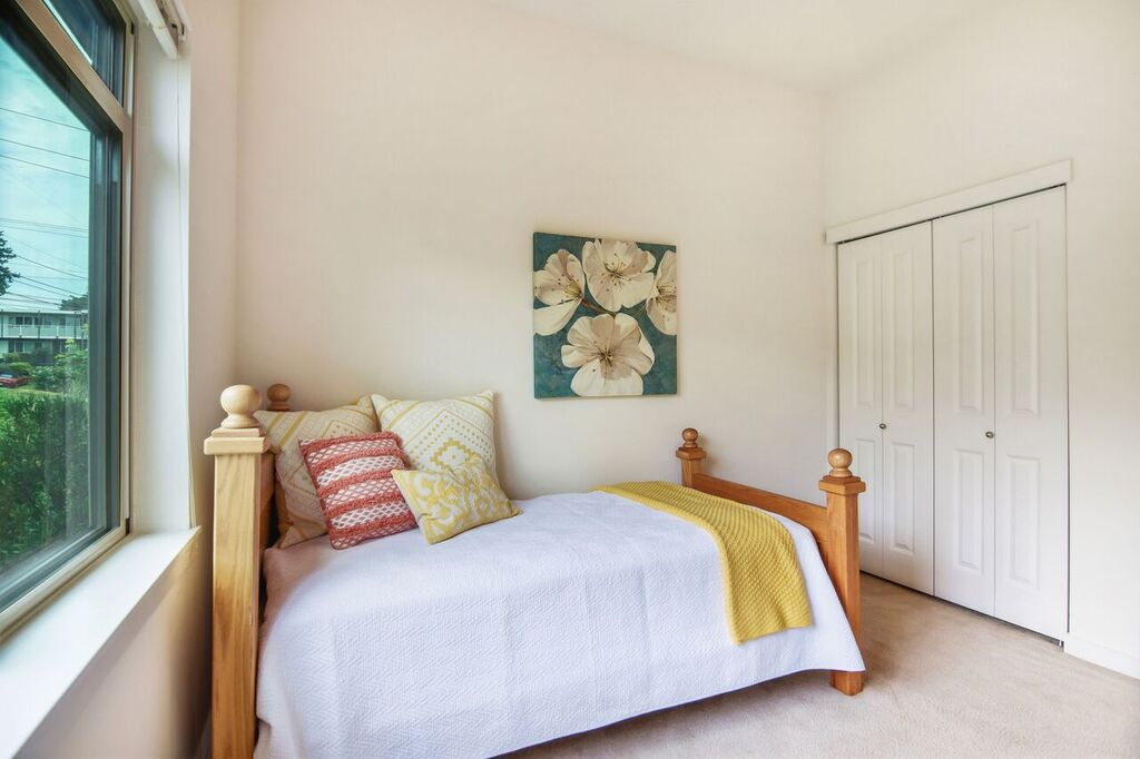 Find a big closet and tall ceilings in this 2nd bedroom.