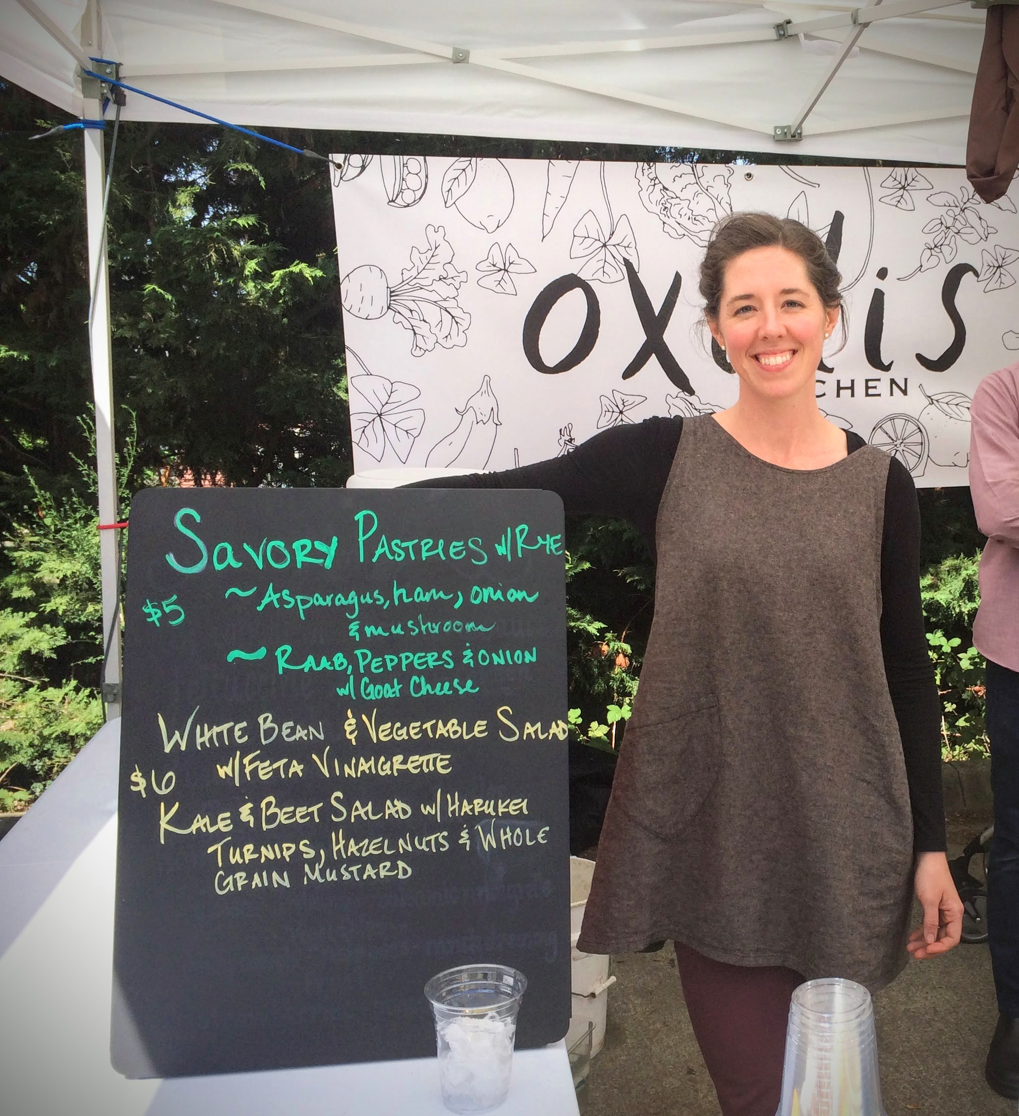 Oxalis Kitchen's first day at the market with chef Darice Grass getting her menu board all set.