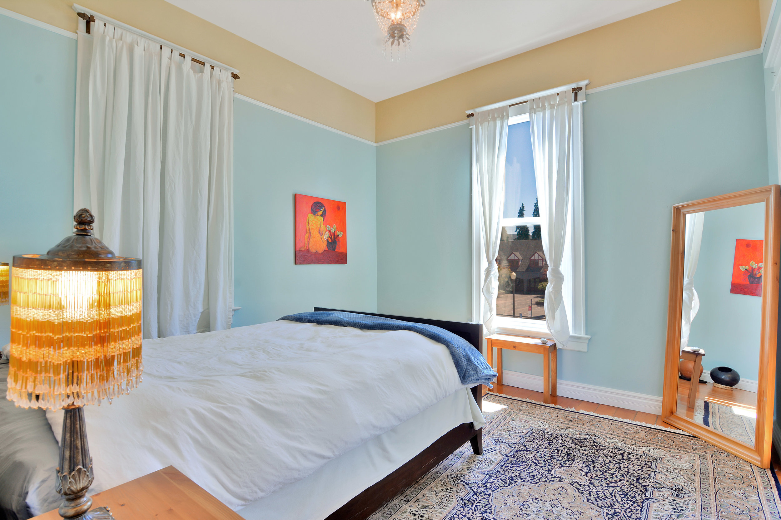 Main bedroom with natural light.