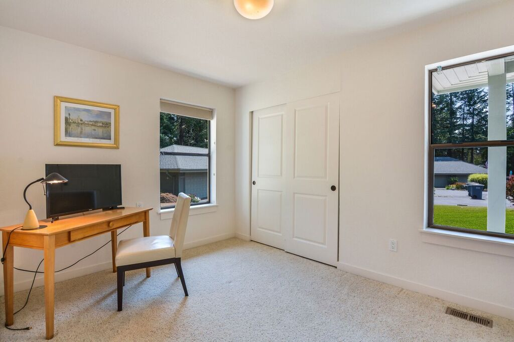 A second bedroom at the front of the house includes a spacious closet, good window light, and would also make a nice office, den, sewing room, or combination.
