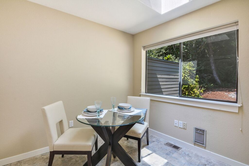 Set a table in the eat-in kitchen's breakfast nook for a cozy kitchen meal lit by the skylight above.