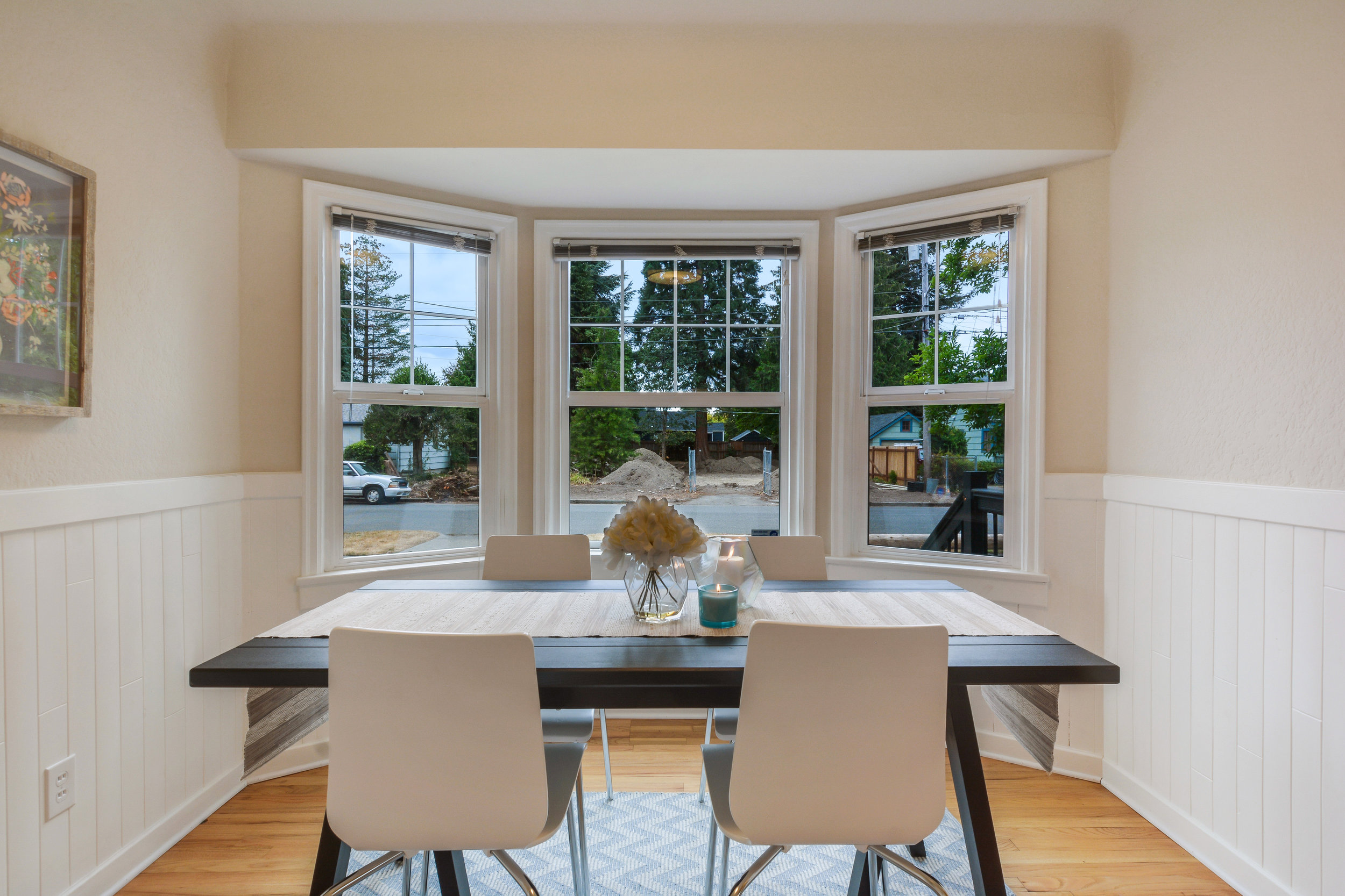 The shape, character, and light these bay windows create is lovely. Set a fancy table, or keep it simple, and casual, either way, this room is pretty.