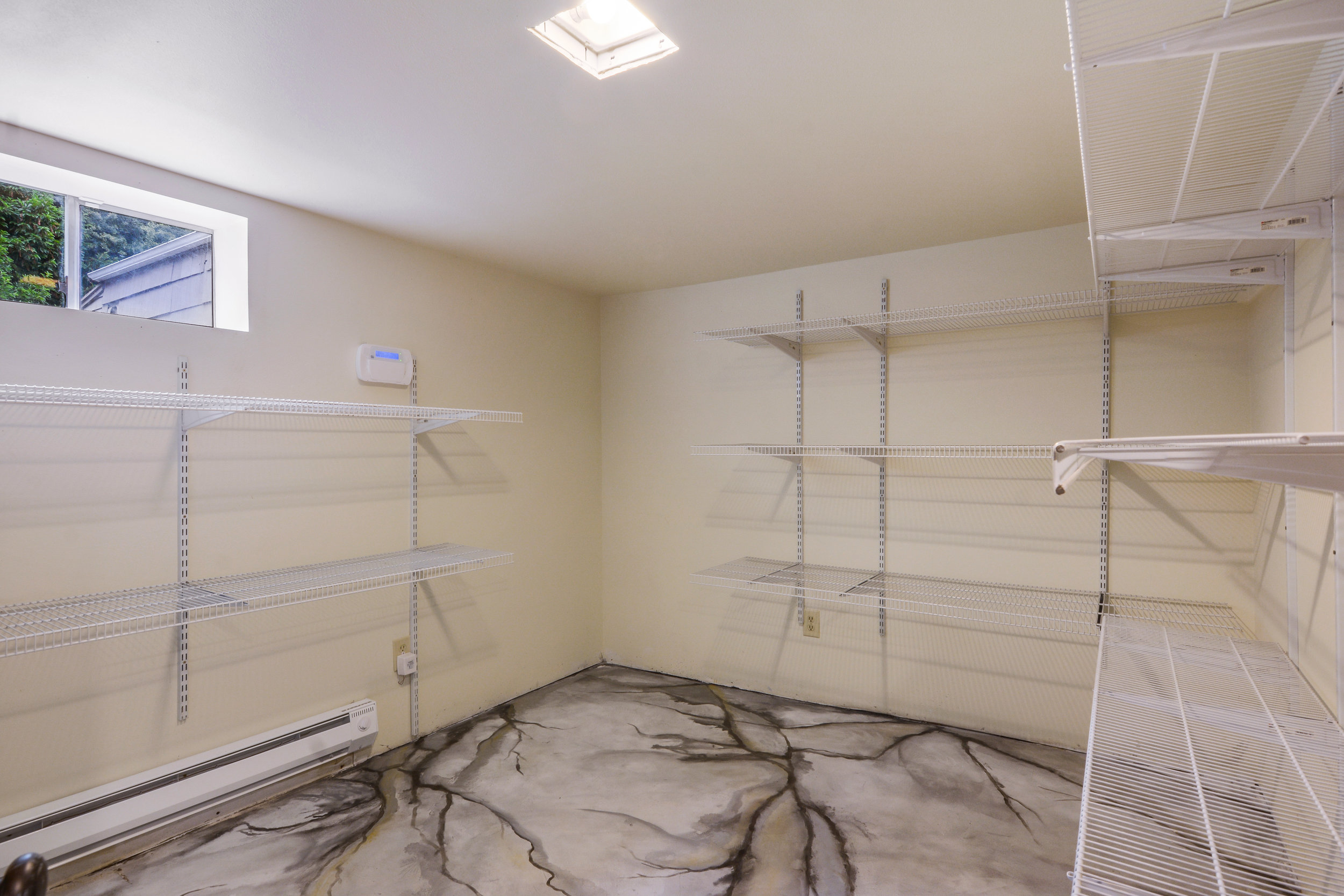 The final room in the basement is this storage room all set with wire shelves to keep the rest of the house uncluttered.