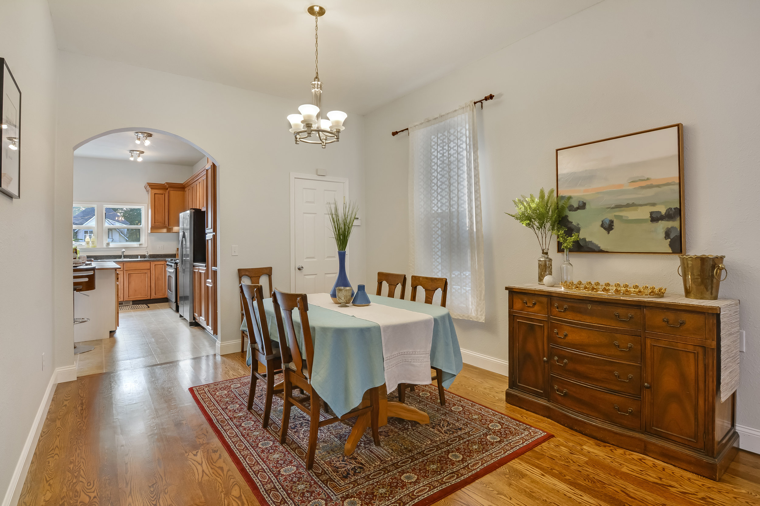 Dining room features an arched opening into the kitchen, a handy closet, and elegantly tall ceilings.