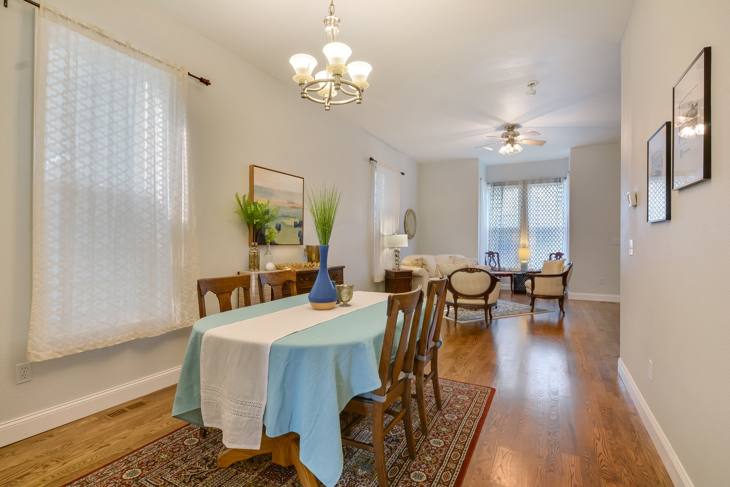 Dining room into the living room on the main floor with its tall ceilings and solid oak floors.