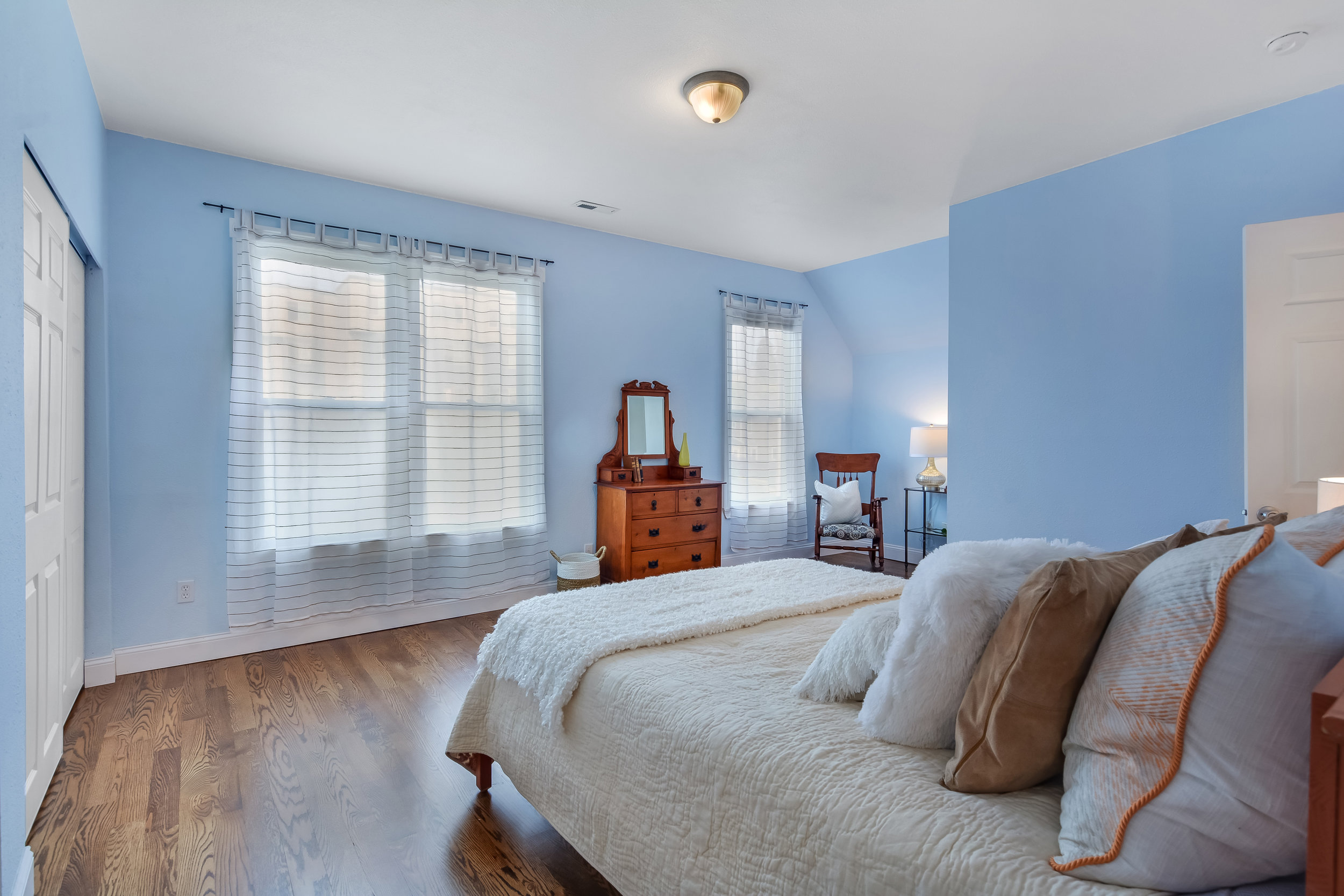Another view of the large upstairs bedroom with its spacious clothes closet and lots of window light.