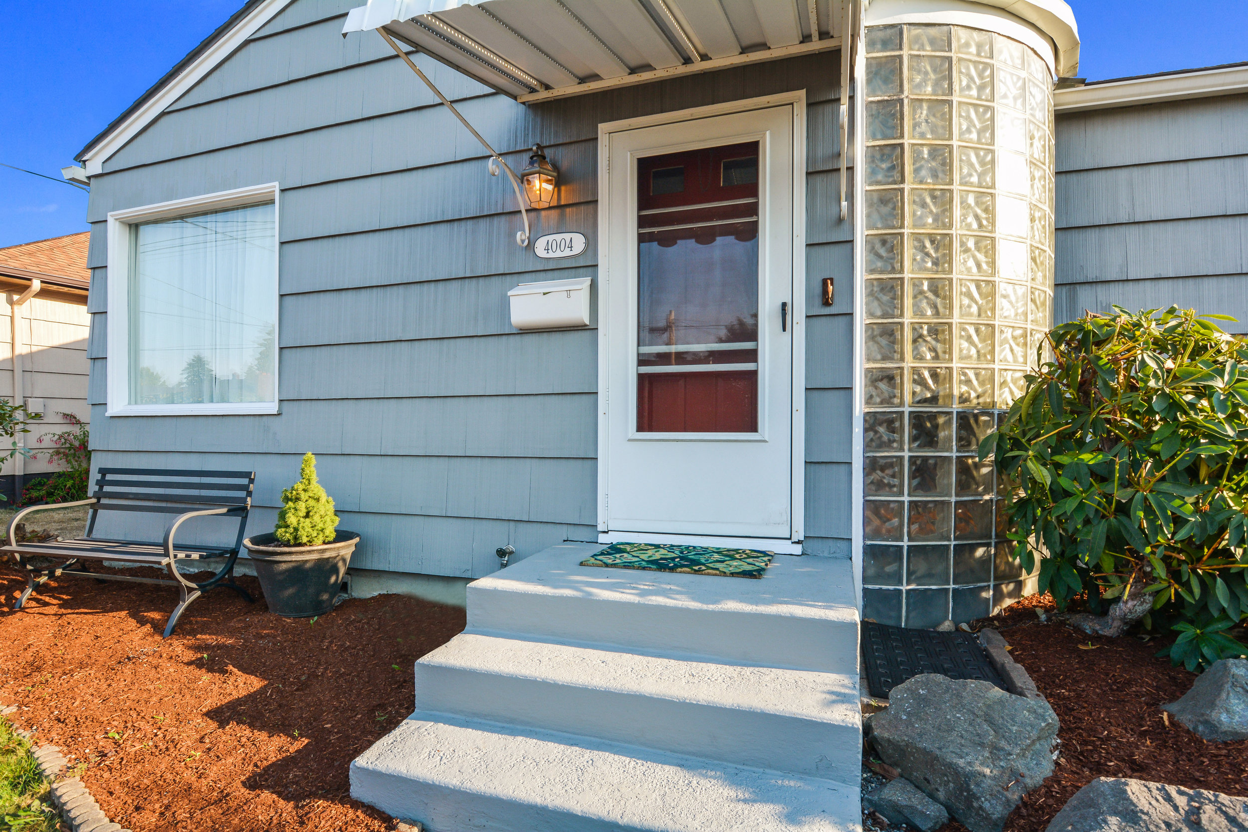A closer look at the fresh paint, front porch and curved glass block entry at 4004 N 12th.