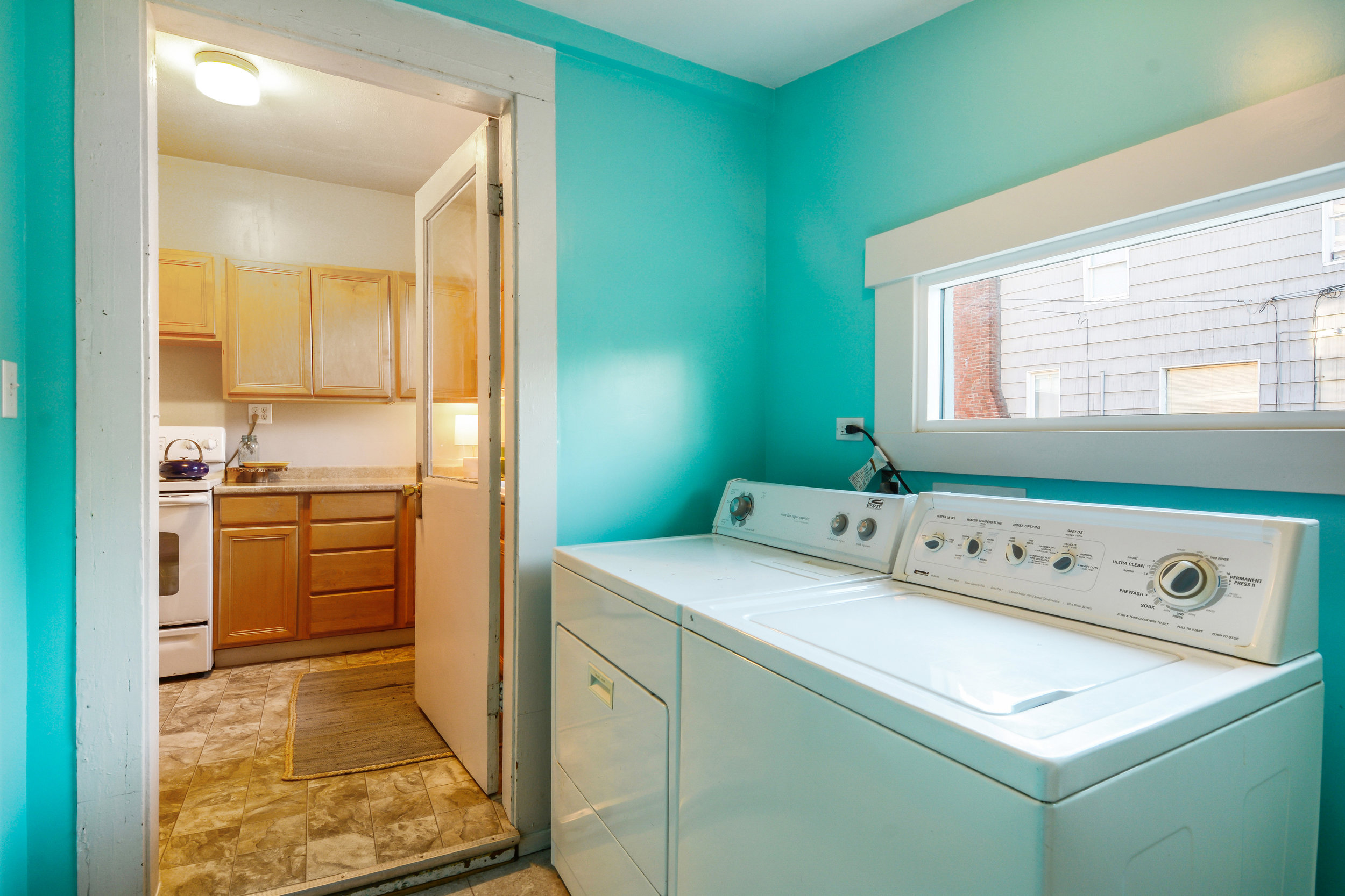The bright laundry room is located conveniently off the kitchen.