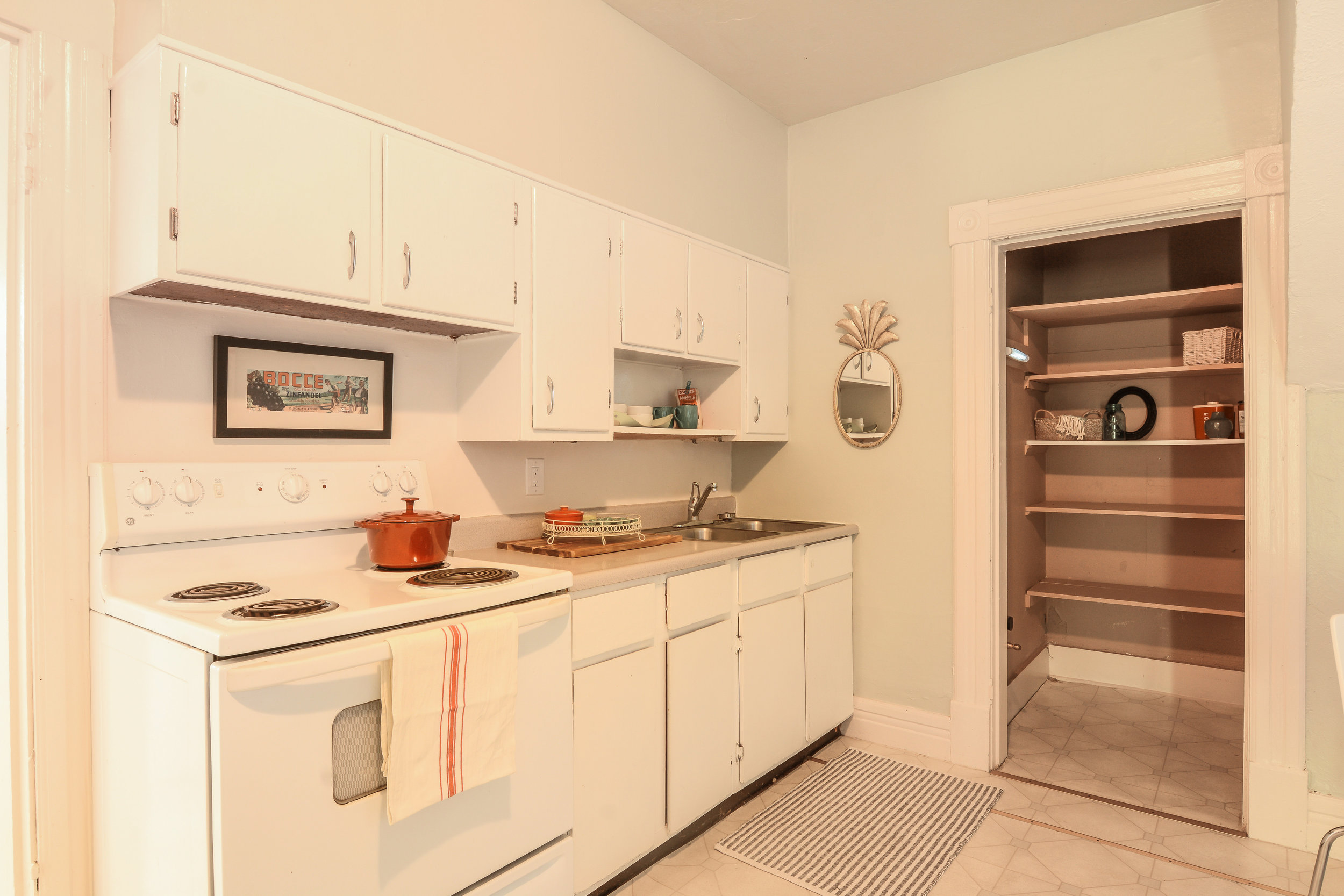 Having a pantry frees up more space in the cabinets for dishes and kitchen tools.