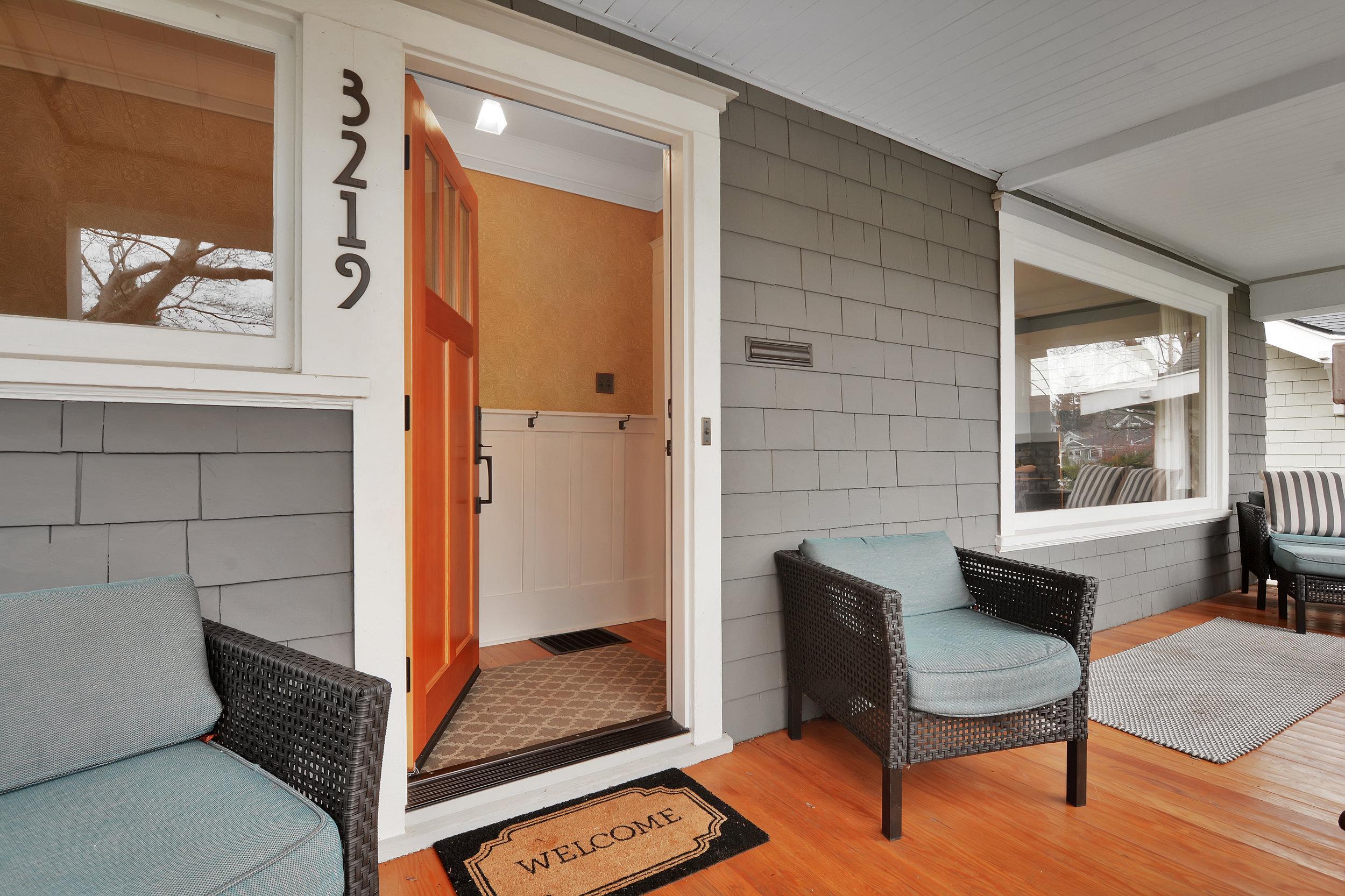 Front door detail. Cedar shake siding, fir flooring, and double pane storm windows.