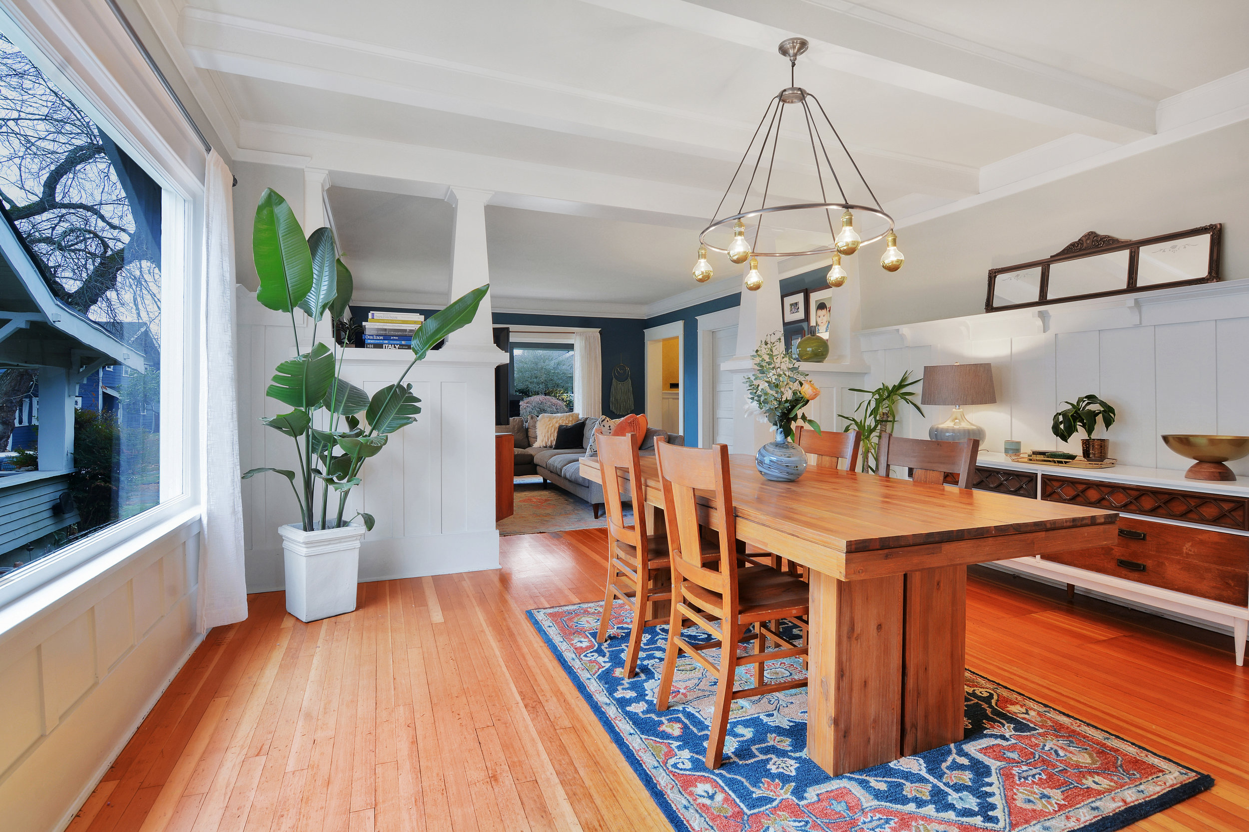 Spacious enough for a dining table and sideboard, this beautiful room fills with natural light from the picture window.