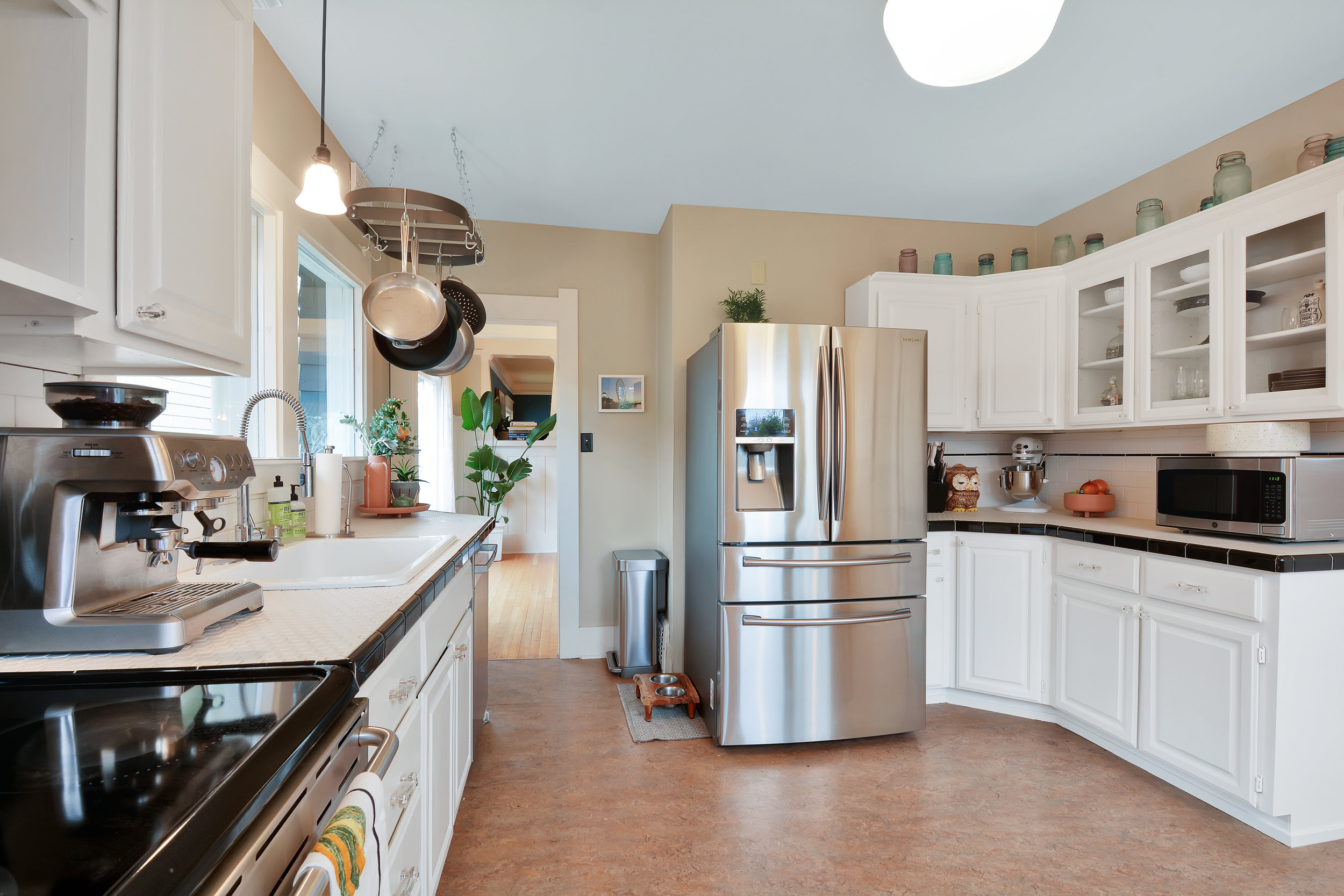 Stainless appliances and bright white cabinets create a classic kitchen.