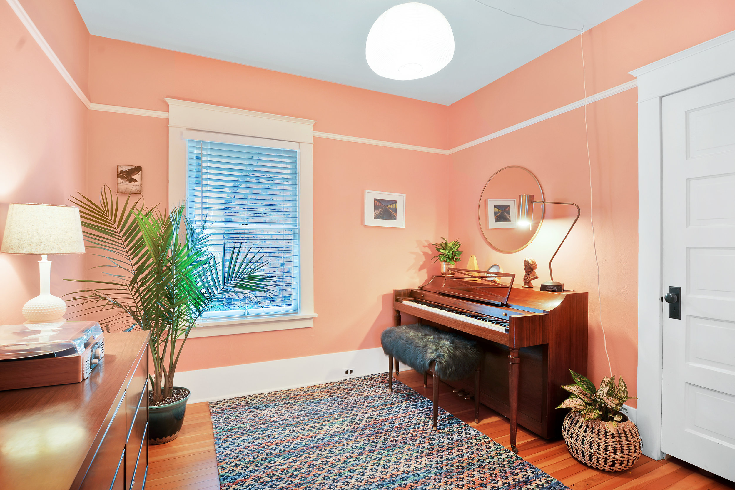 One of three main floor bedrooms, currently used as a cozy music room.
