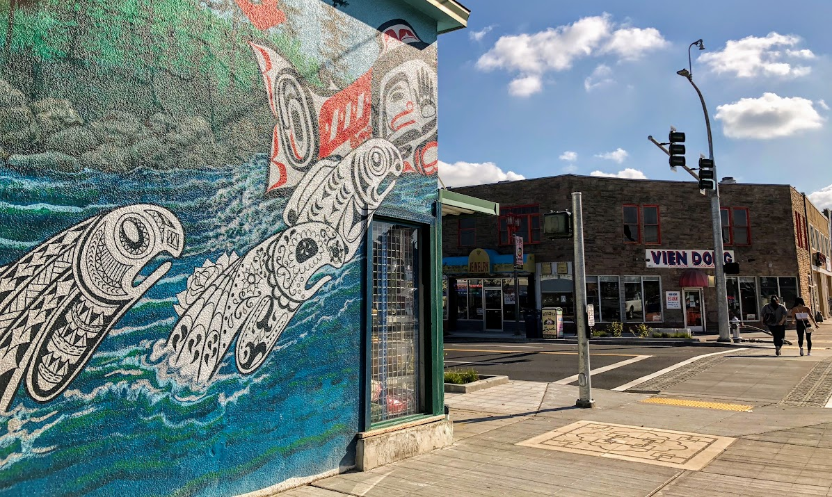 Bob Henry's Leaping Salmon Mural on the corner of S 38th & Yakima with Vien Dong in the background.