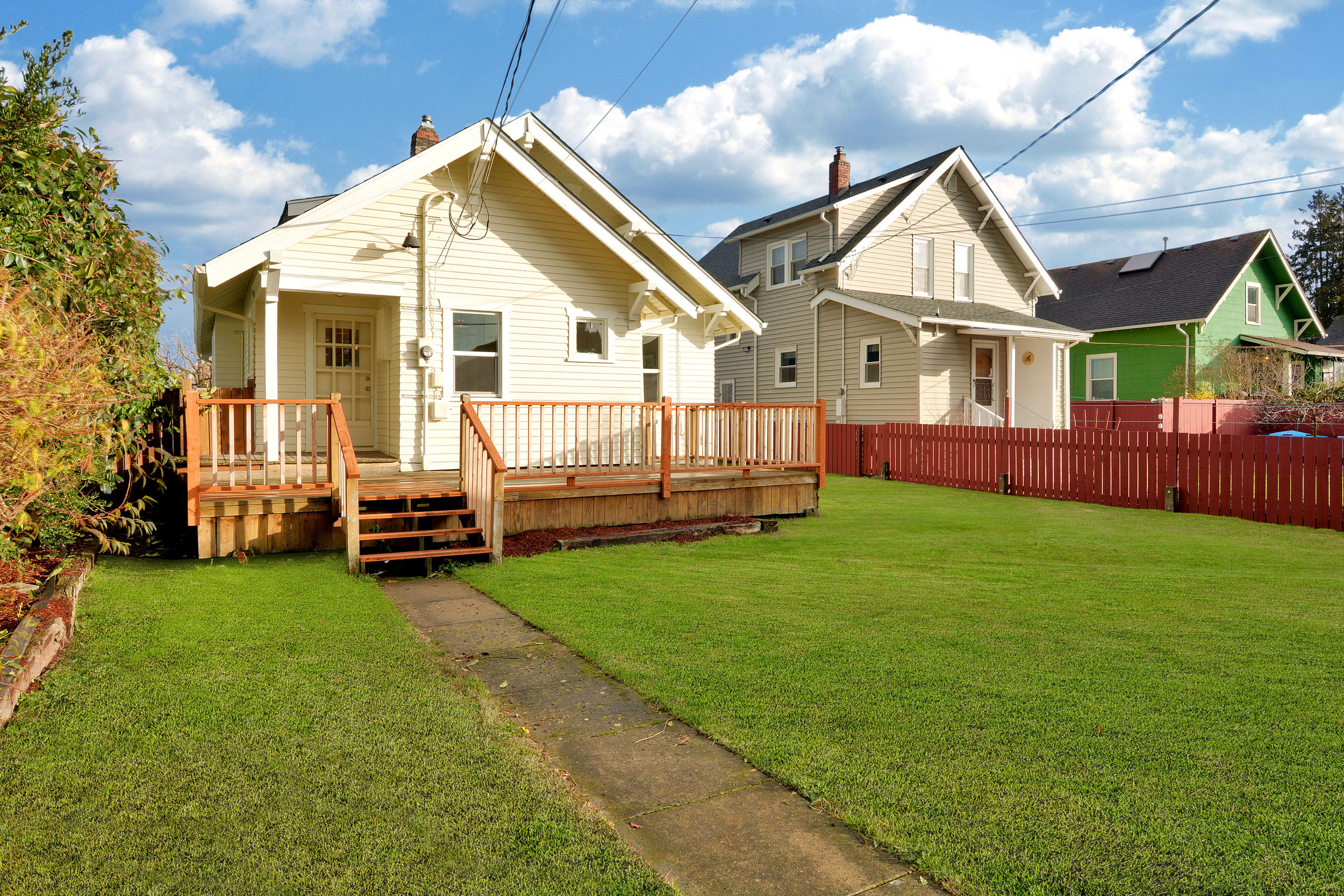 The fully-fenced back yard is big with a wooden deck right off the kitchen!