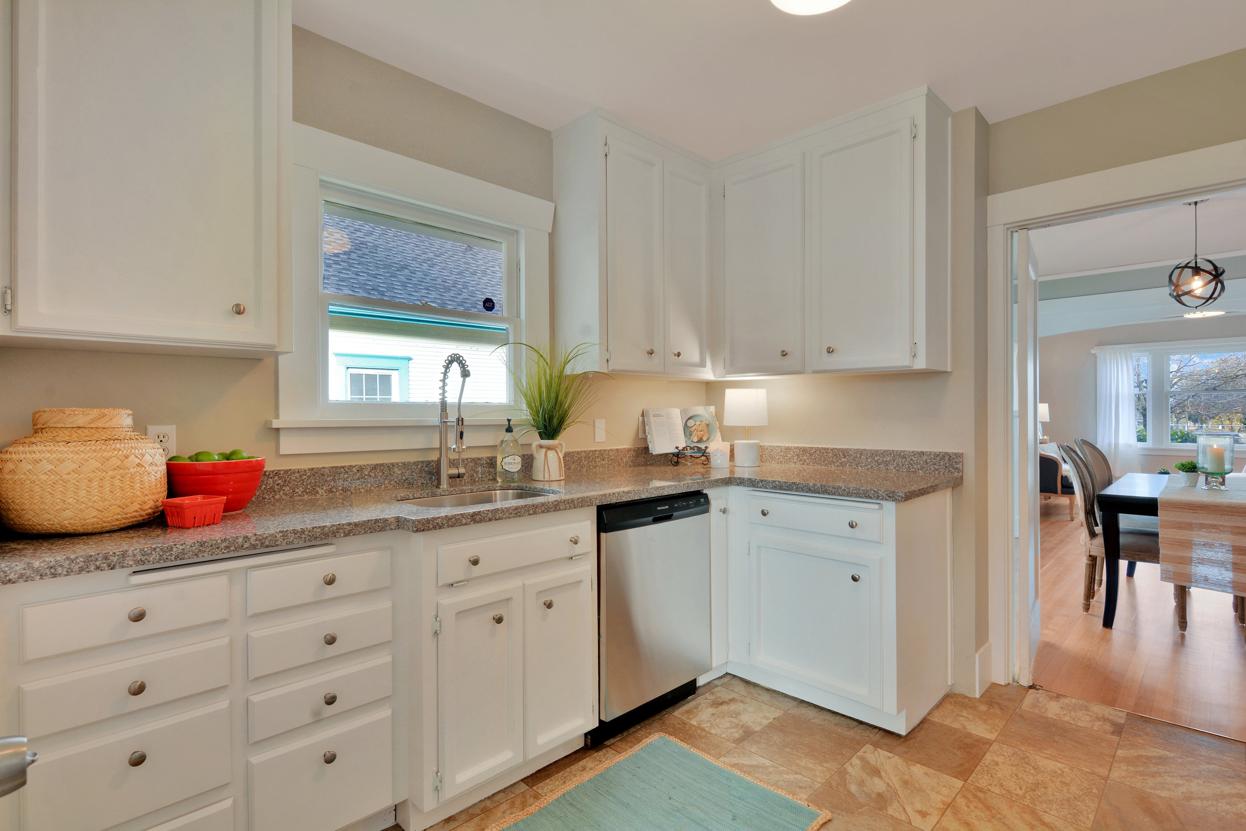 The eat-in kitchen features new countertops and new stainless undermount sink to match the full set of stainless appliances.