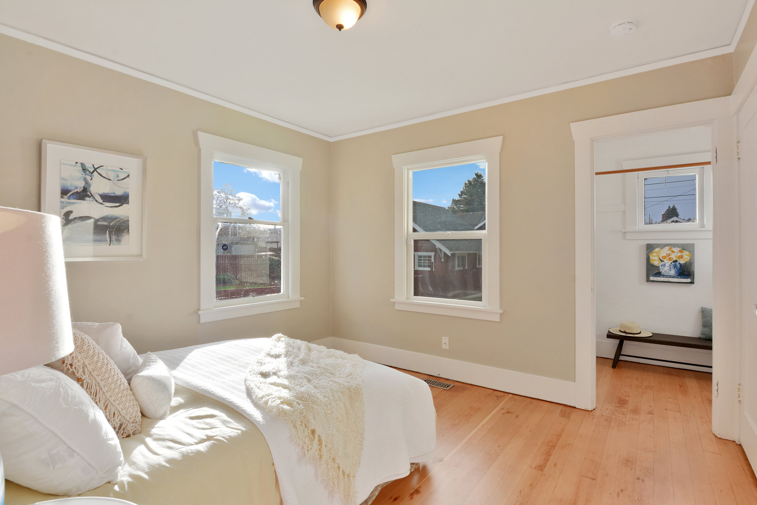 One of two main floor bedrooms with refinished fir floors. This room, at the back of the house, offers a walk in closet, crown molding, and windows facing south and west.