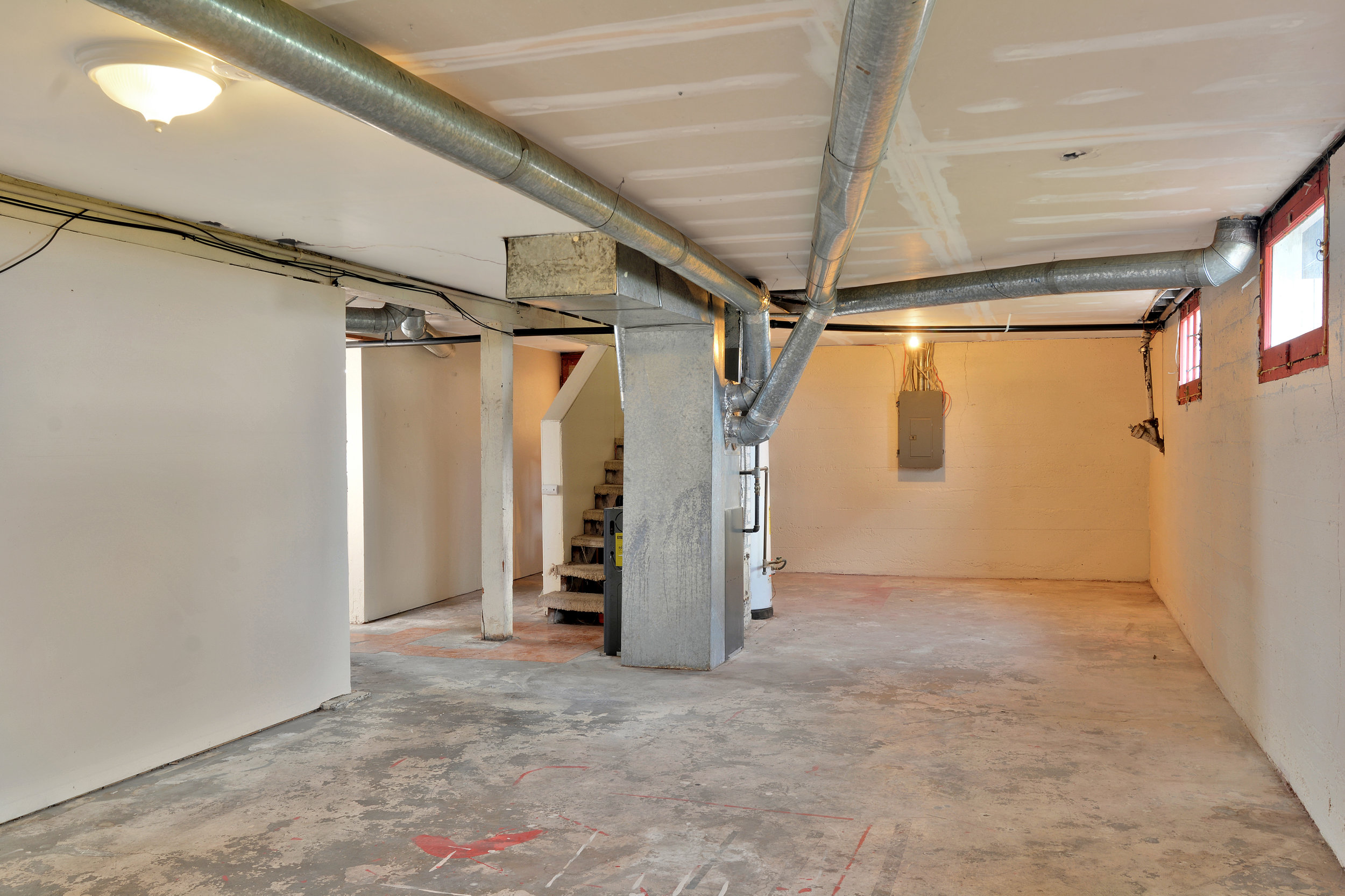 The unfinished basement offers plenty of space for storage, or set up a workshop. The gas furnace and gas water heater are located down here.