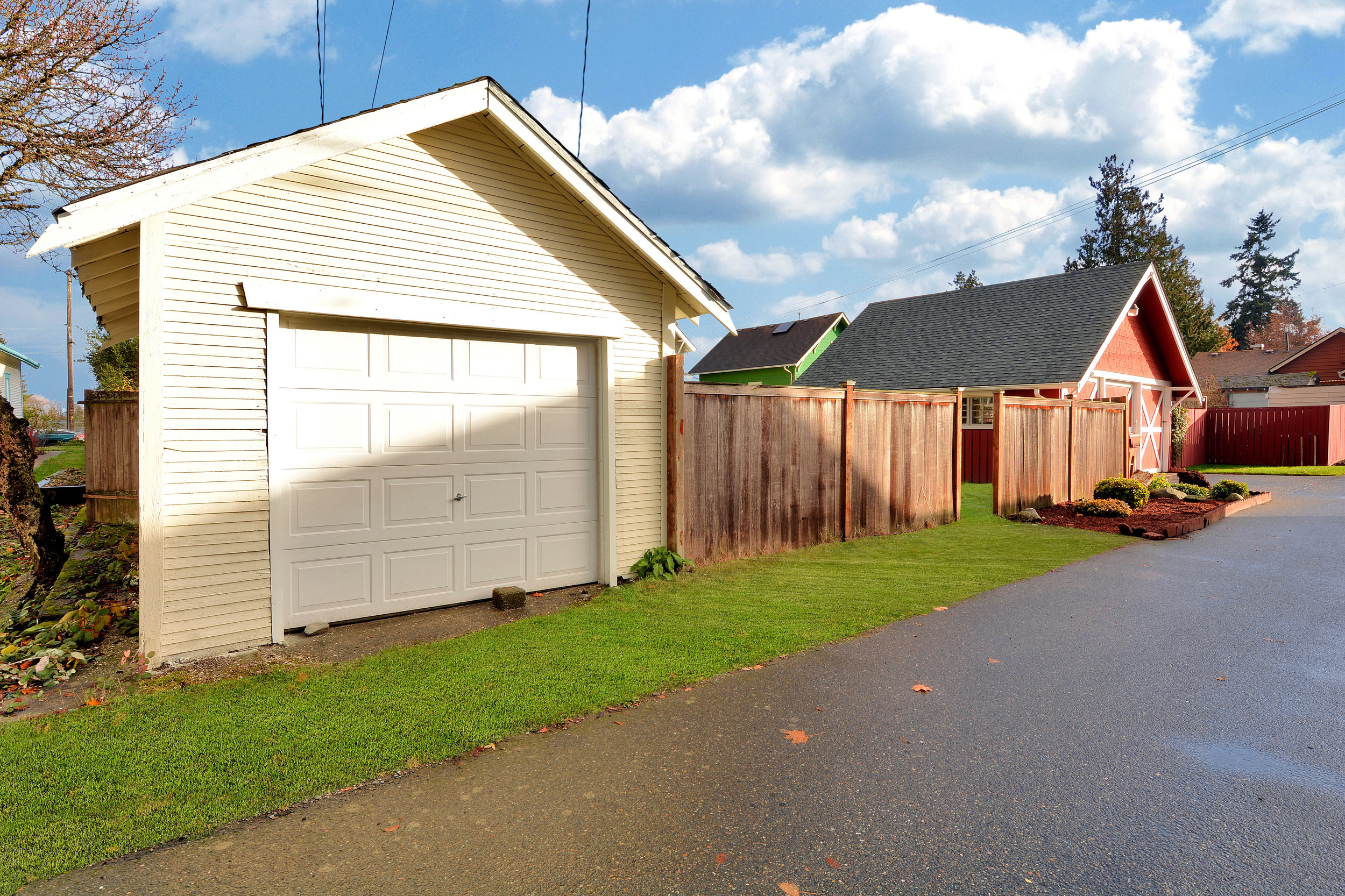 A single car garage borders the alley in the fully-fenced back yard.