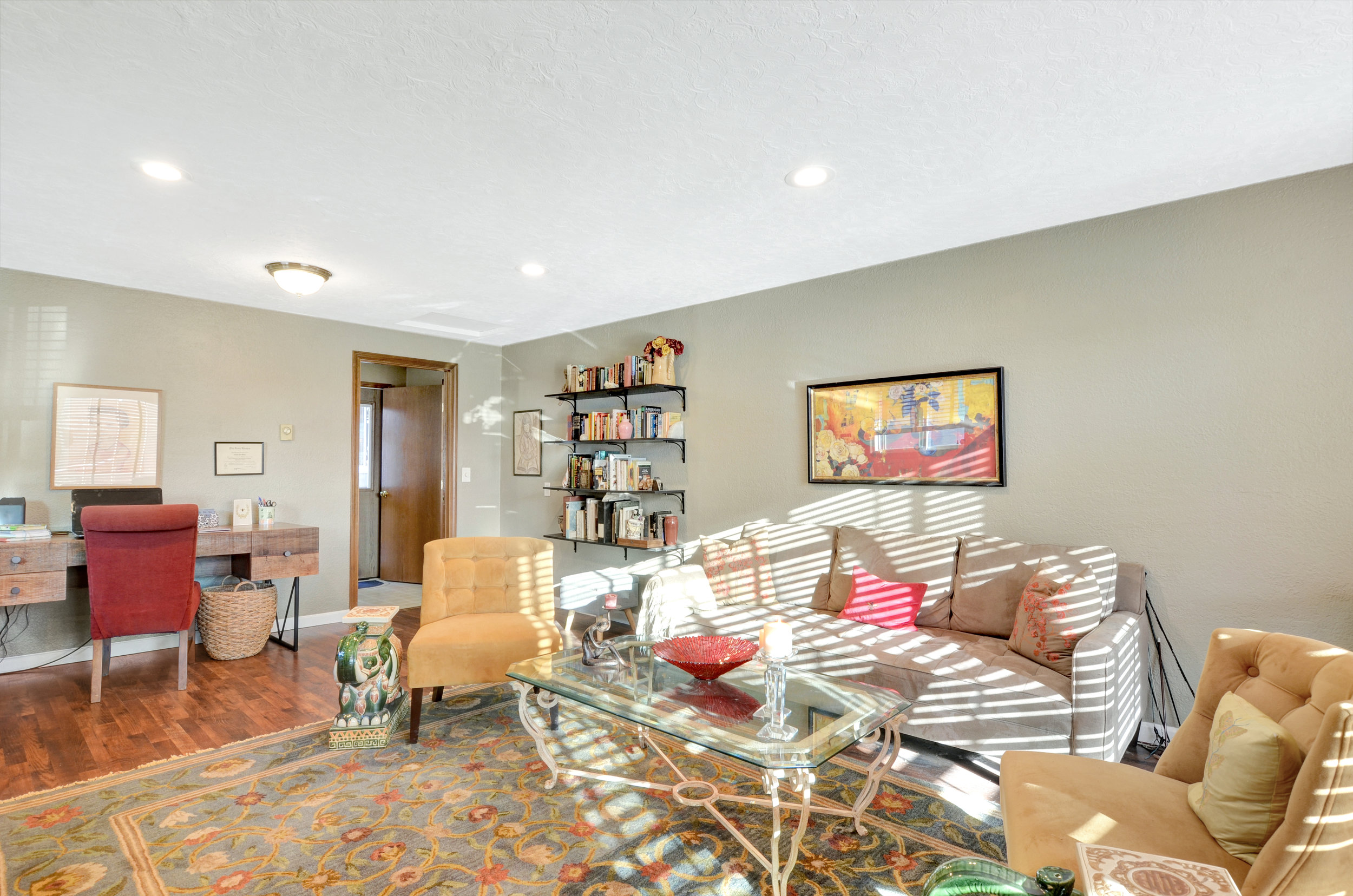 Design this room as a traditional family room for reading, playing games, and watching movies, or set up a home office, studio, or exercise area.