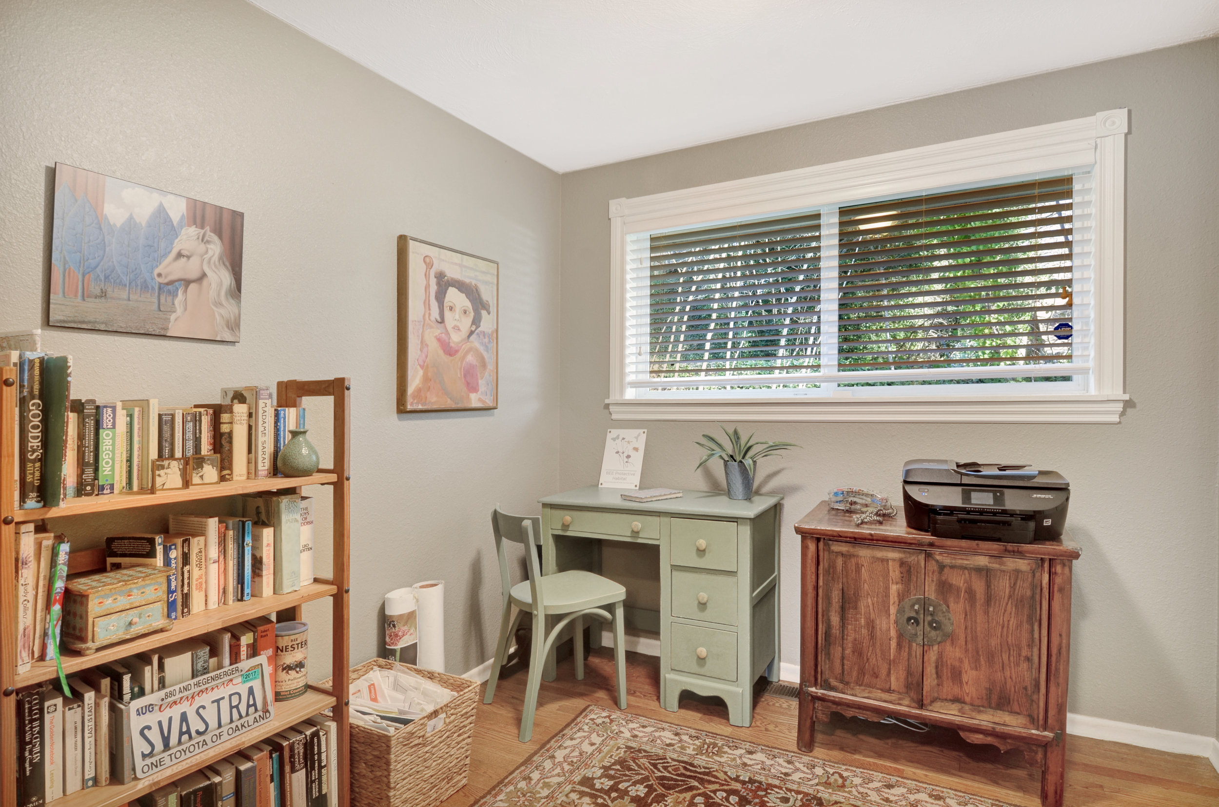 One of 3 bedrooms, this room features original oak hardwood floor and fresh paint as found throughout the home.