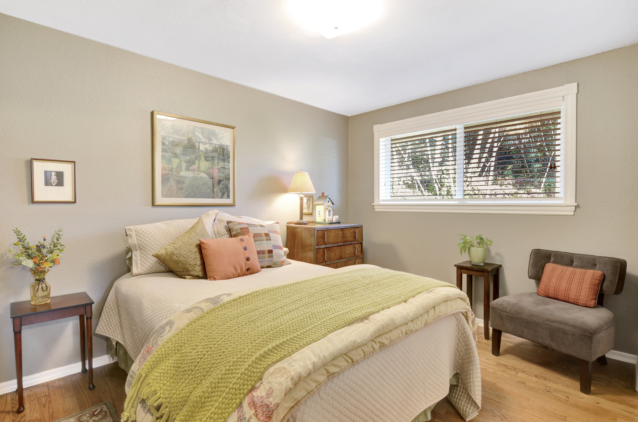 Another fresh and comfortable bedroom with original oak floors, window light, and crisp paint. Find this bedroom with its spacious closet at the end of the hall leading from the front living room.