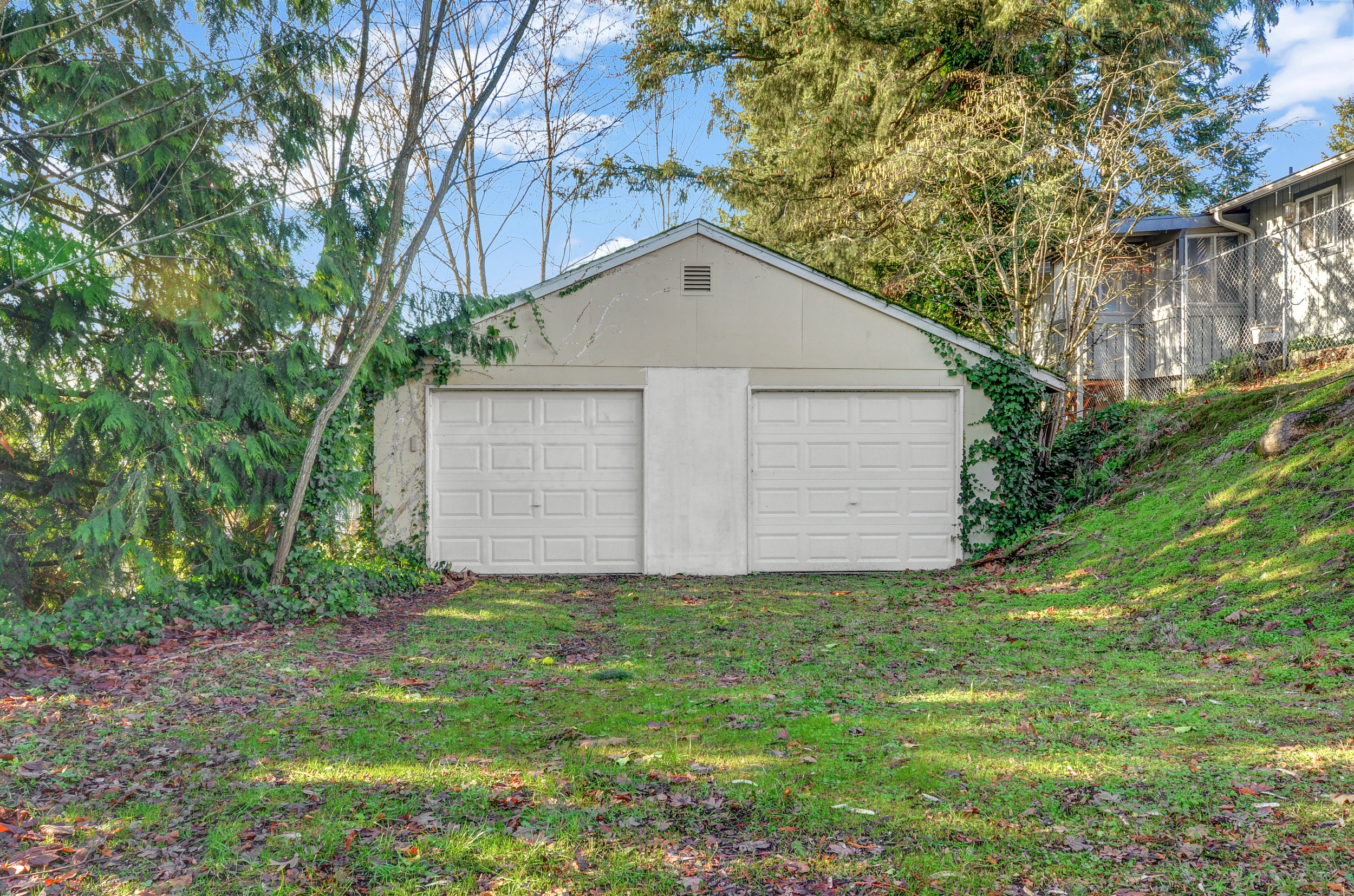 This large lot includes a two-car garage, with electric door opener, work bench, and machine shop area.