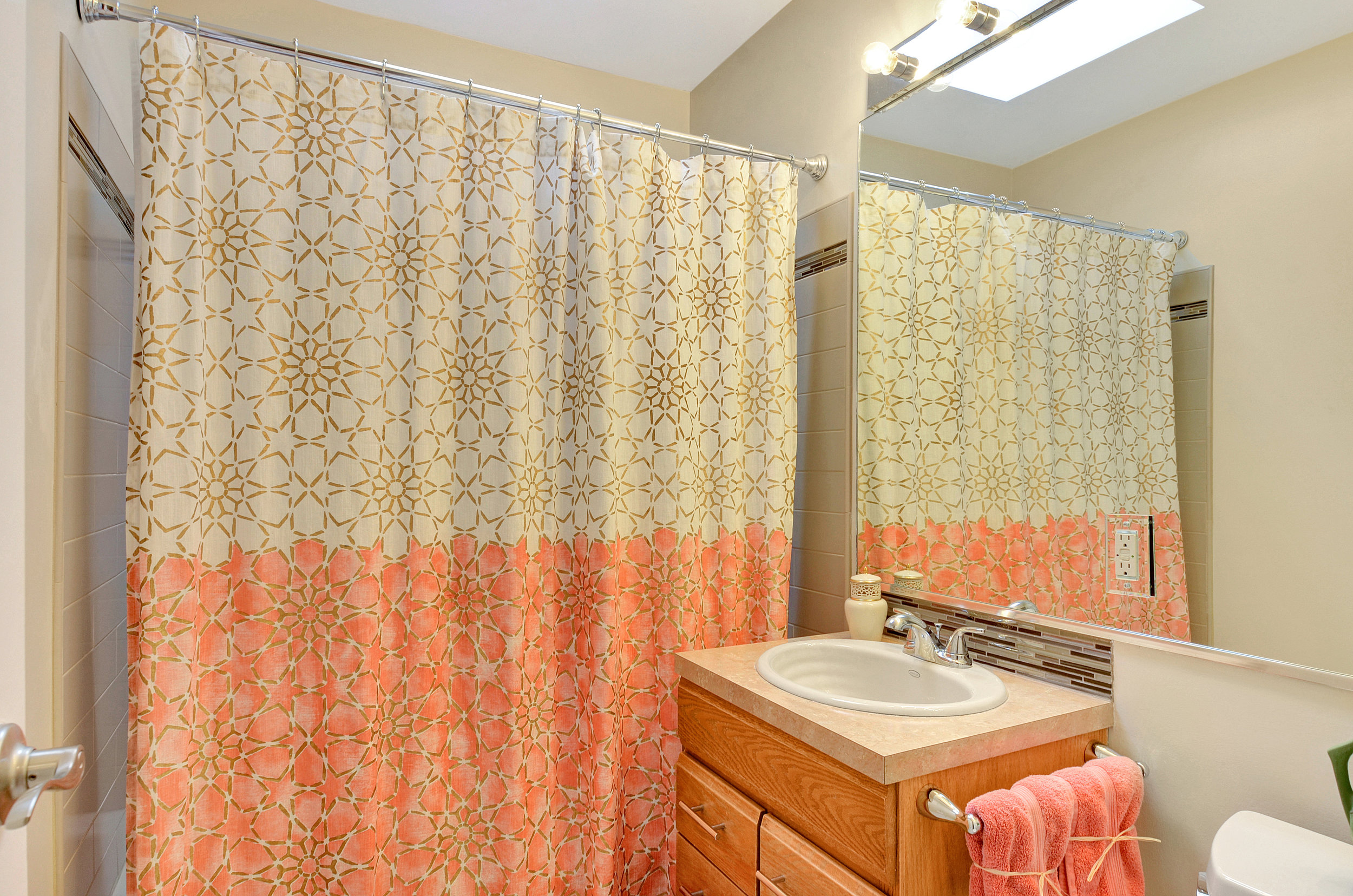 Also note that along with all the new features in this updated bathroom, there is also a new hot water tank for this home to keep showers and baths comfortable and warm.