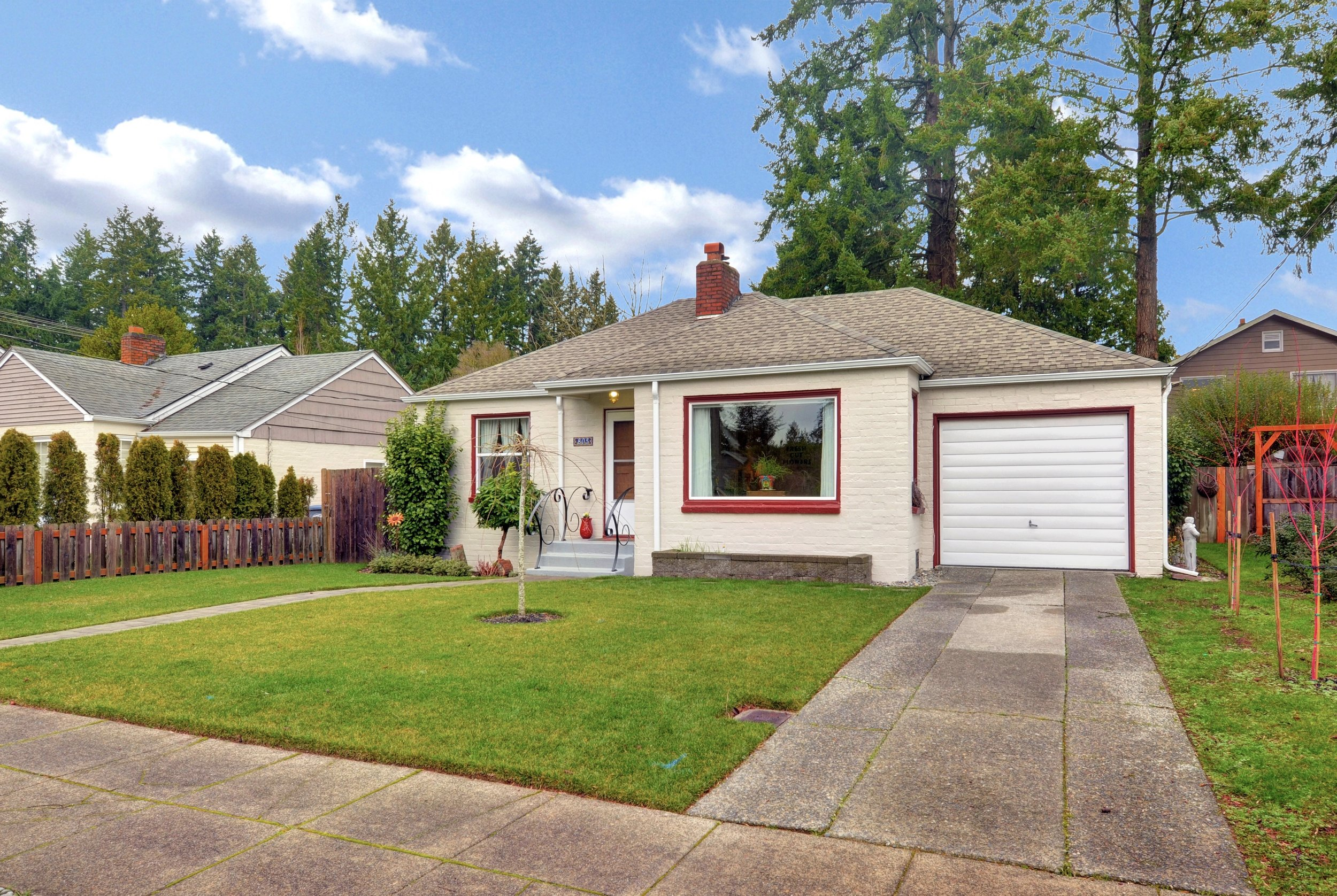 Fresh exterior paint, new sod, and new paving stone pathways make for curb appeal.
