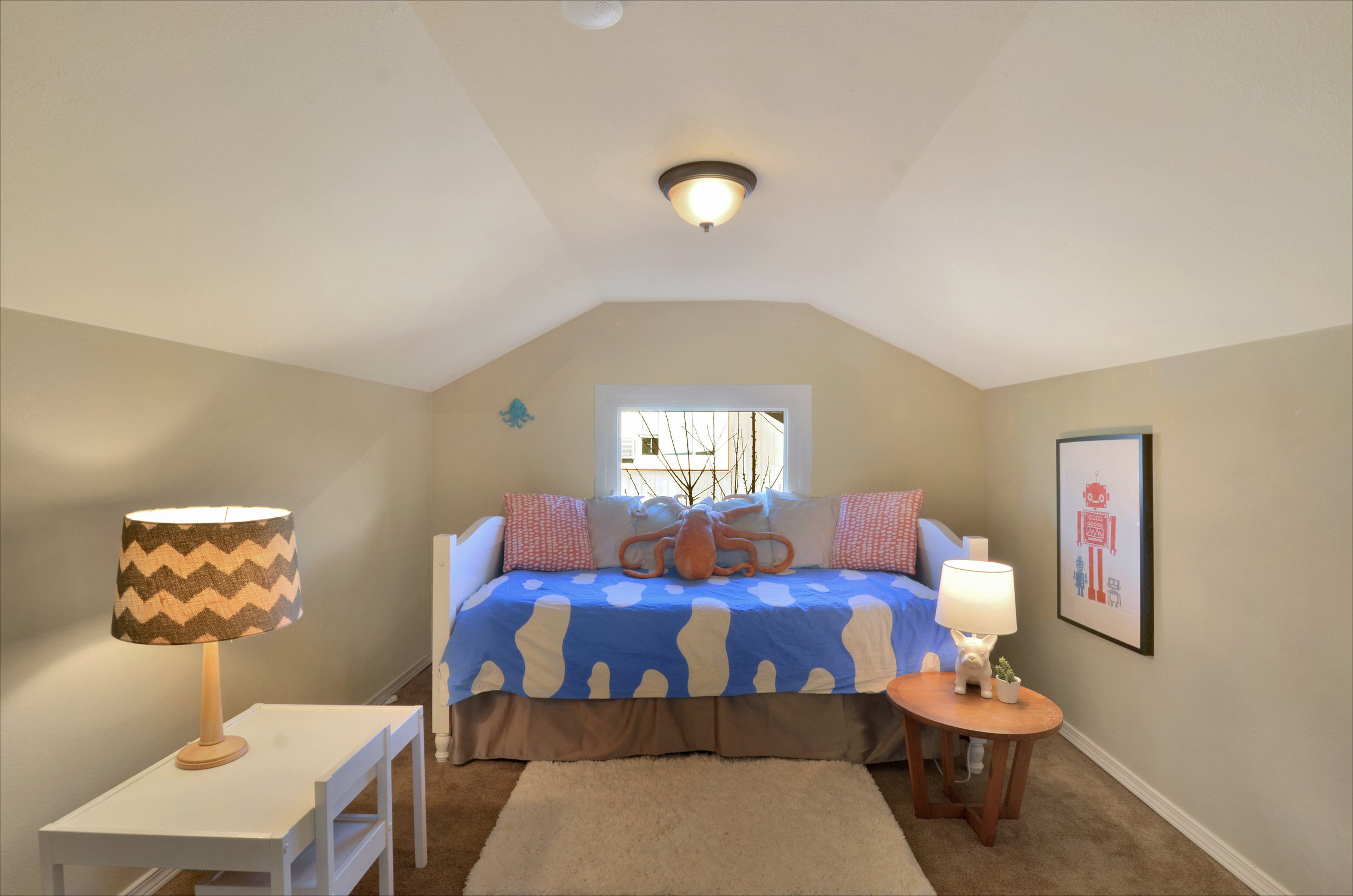 Upstairs bedroom with window facing north, perfect for a teen, roommate, guest, or even an independent kiddo.