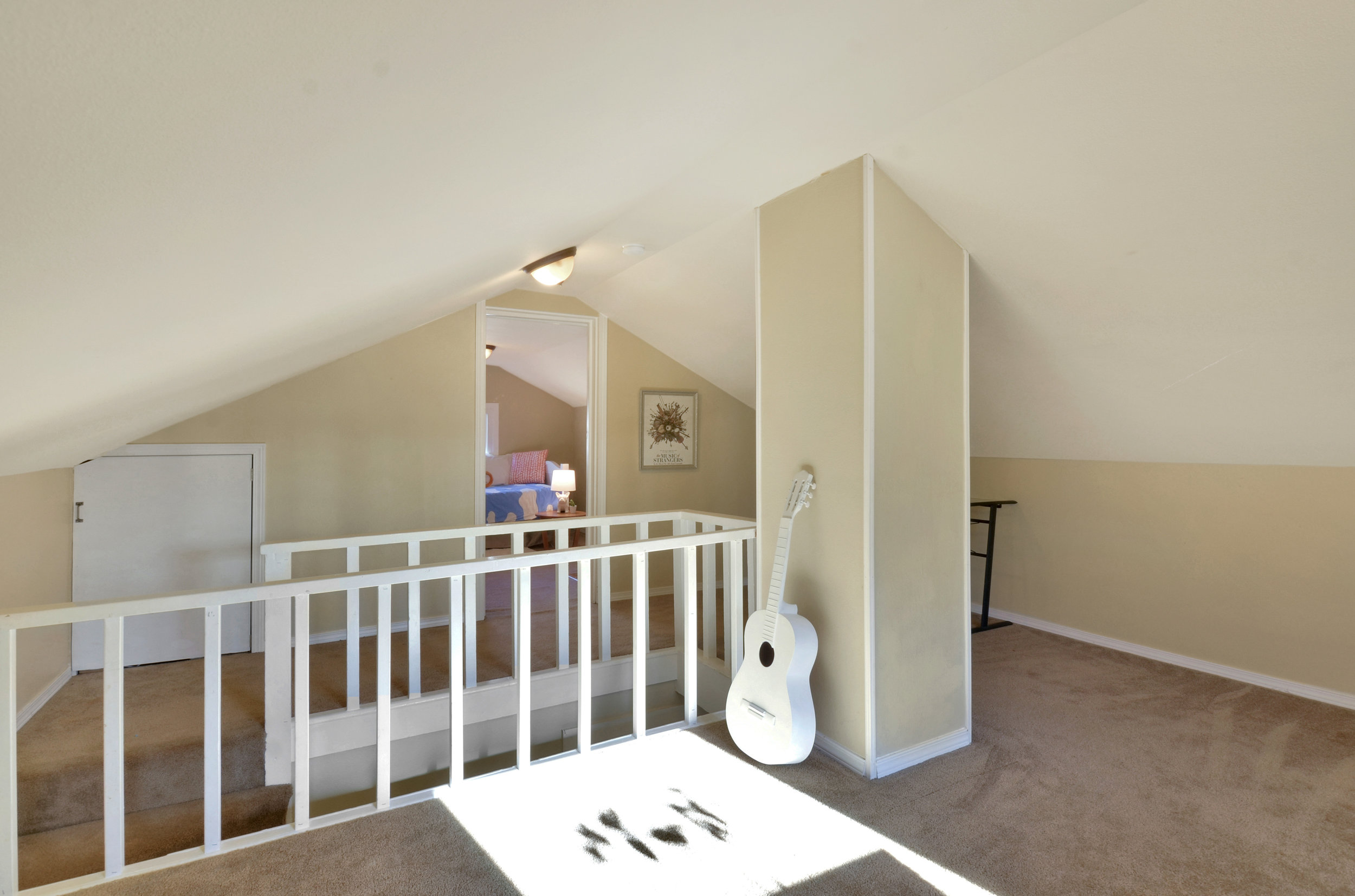 In the freshly painted second floor find a landing leading to one bedroom, with a flexible living space on the other side. Play room, music room, or even a spot to host the occasional guest.