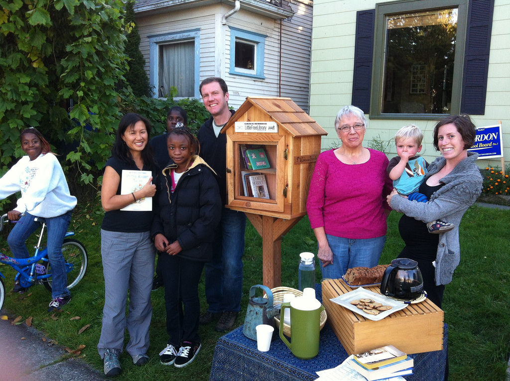 Image from    LittleFreeLibrary.org   .  Leigh and John gathering with a group of neighbors to celebrate their Little Free Library.