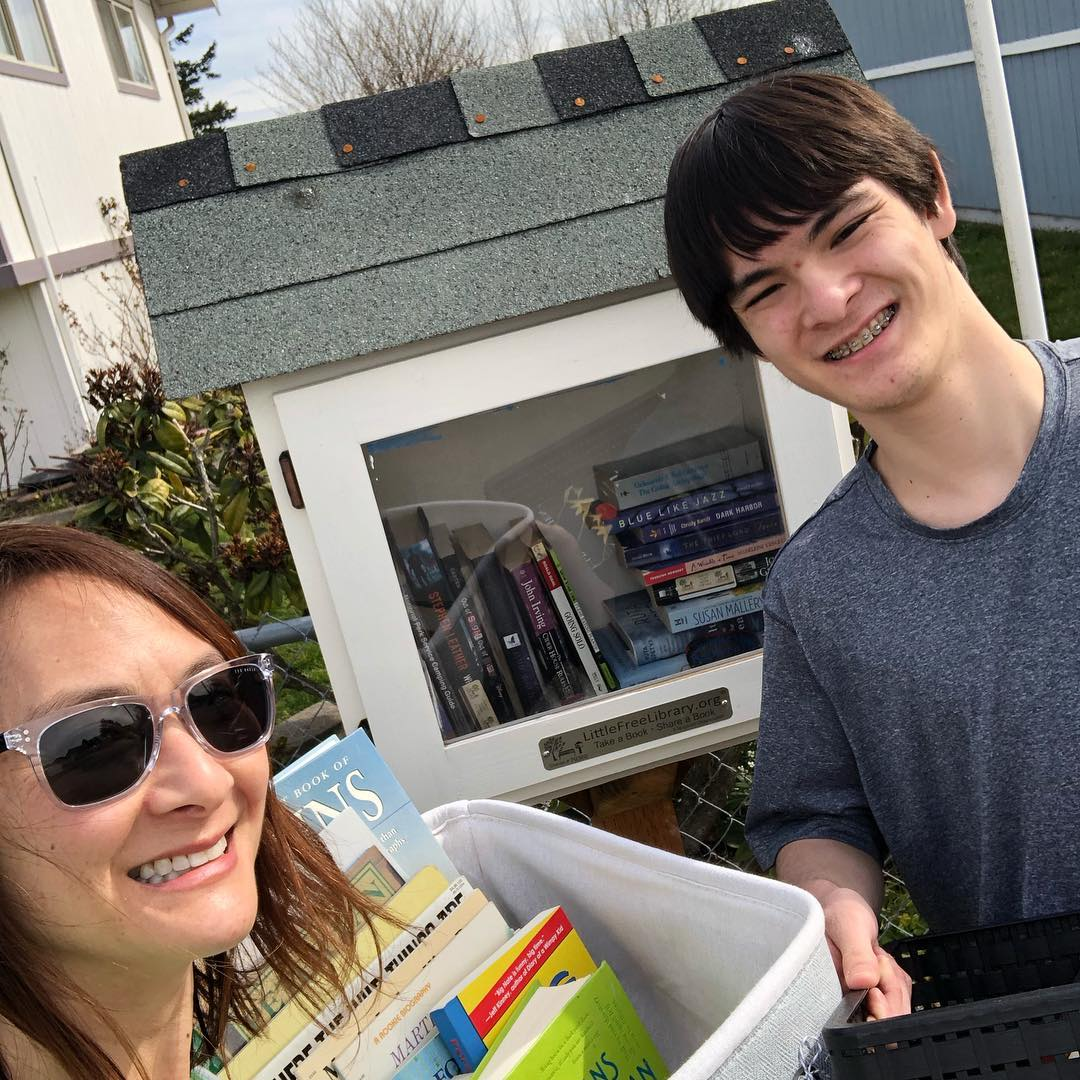 Dr. Jamie and her son making a special delivery to stock one of our featured little libraries. Let's keep filling those libraries. Thanks so much for all you've given!